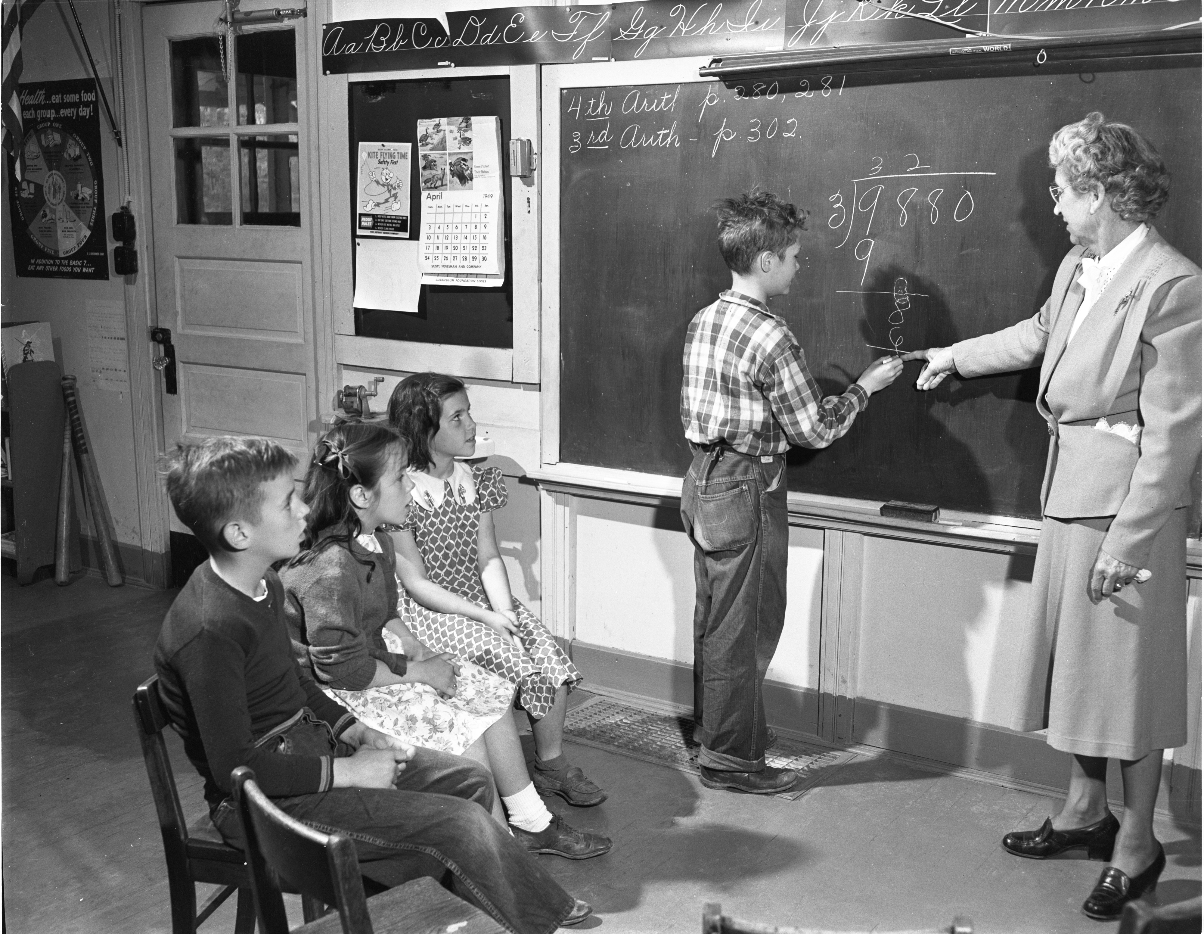Mary Mitchell Oversees A Math Lesson In Her Pittsfield School District Classroom, March 1949 image