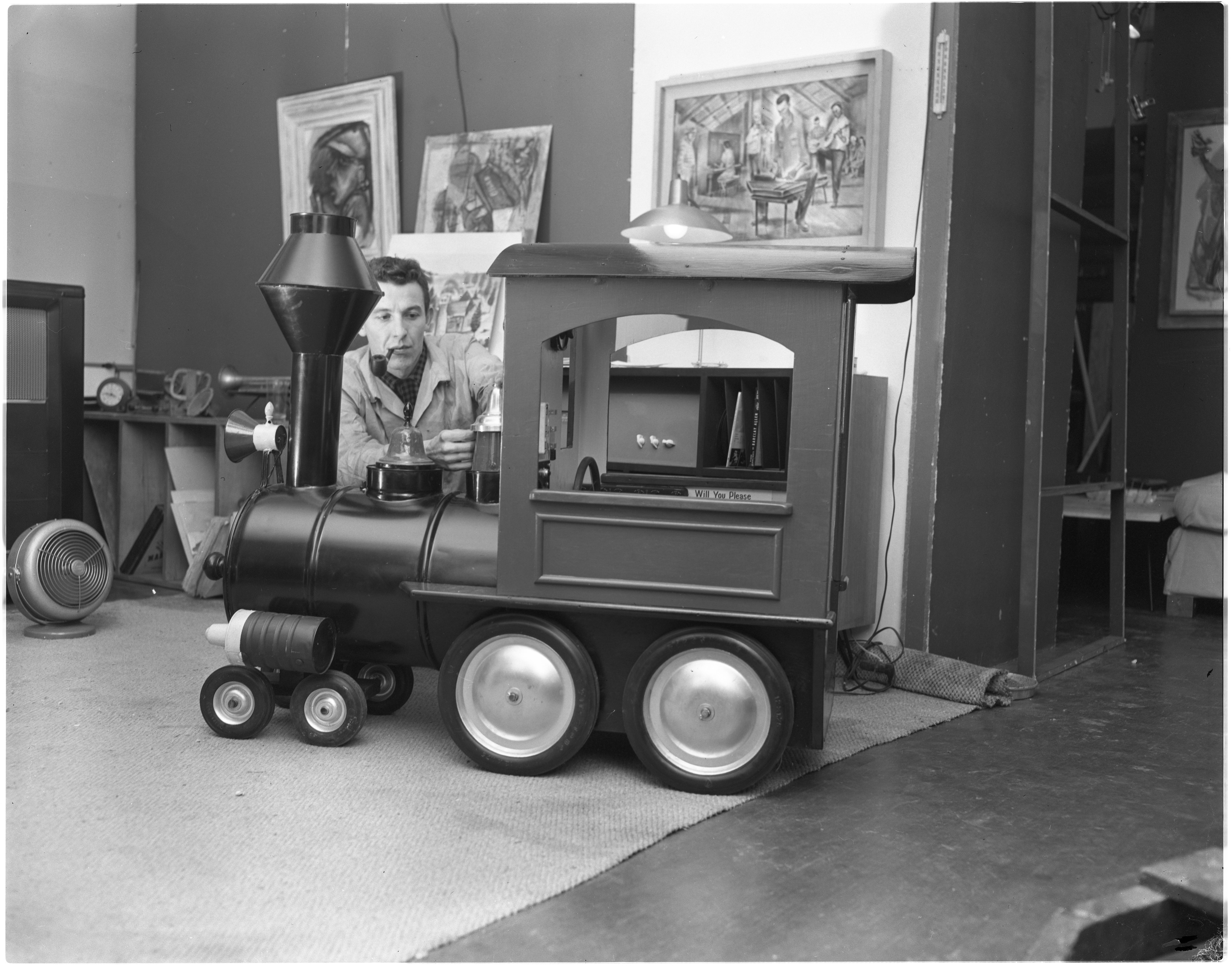 C. William Moss Demonstrating Handmade Locomotive, December 1955 image