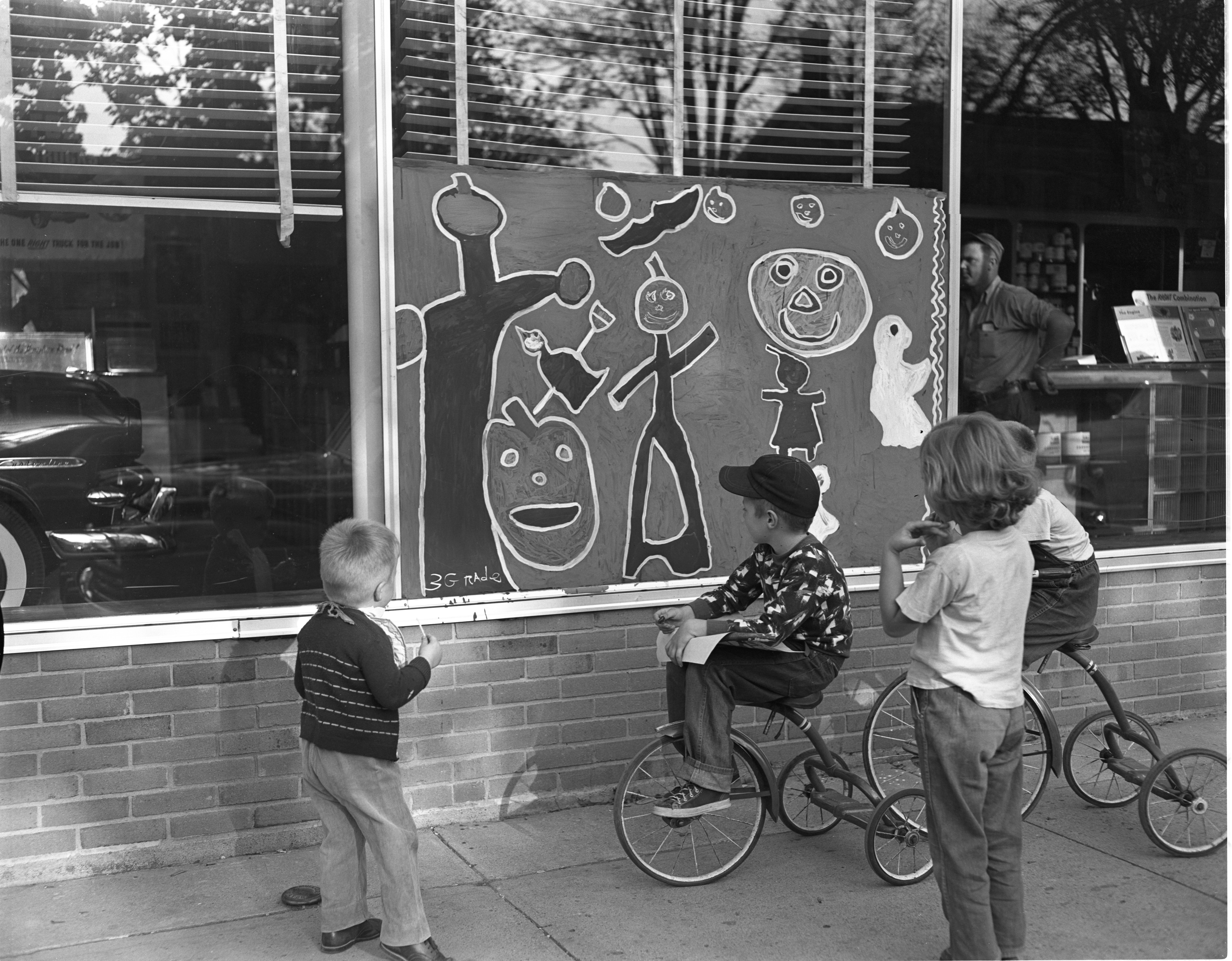 Children's Halloween Art Decorates Business Windows In Downtown Saline, October 1953 image