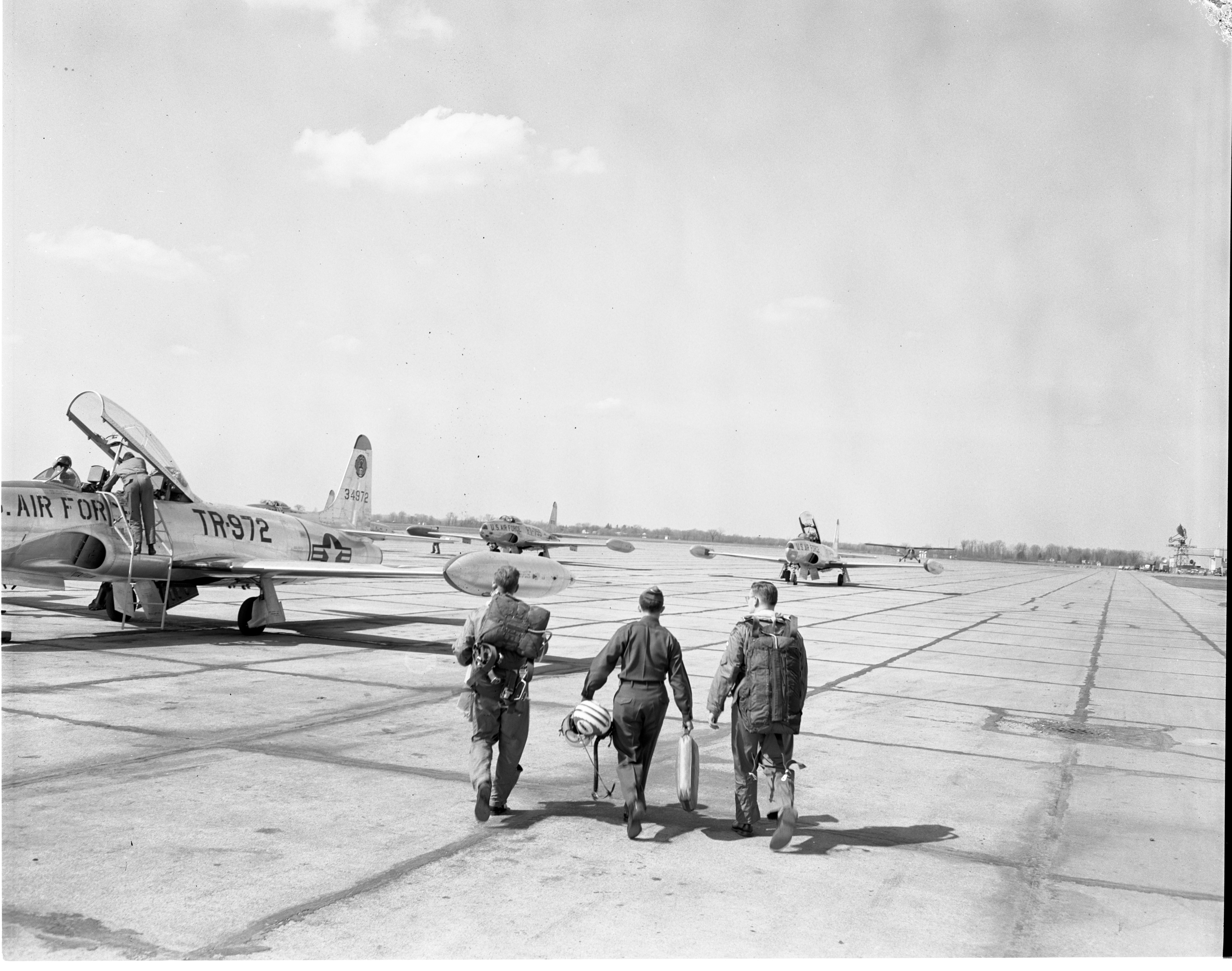 Air Force Lts. Louis G. Marlow & Al Siff Escort Ann Arbor News Reporter Dick Kerr To His Flight At Willow Run Airport, April 1956 image