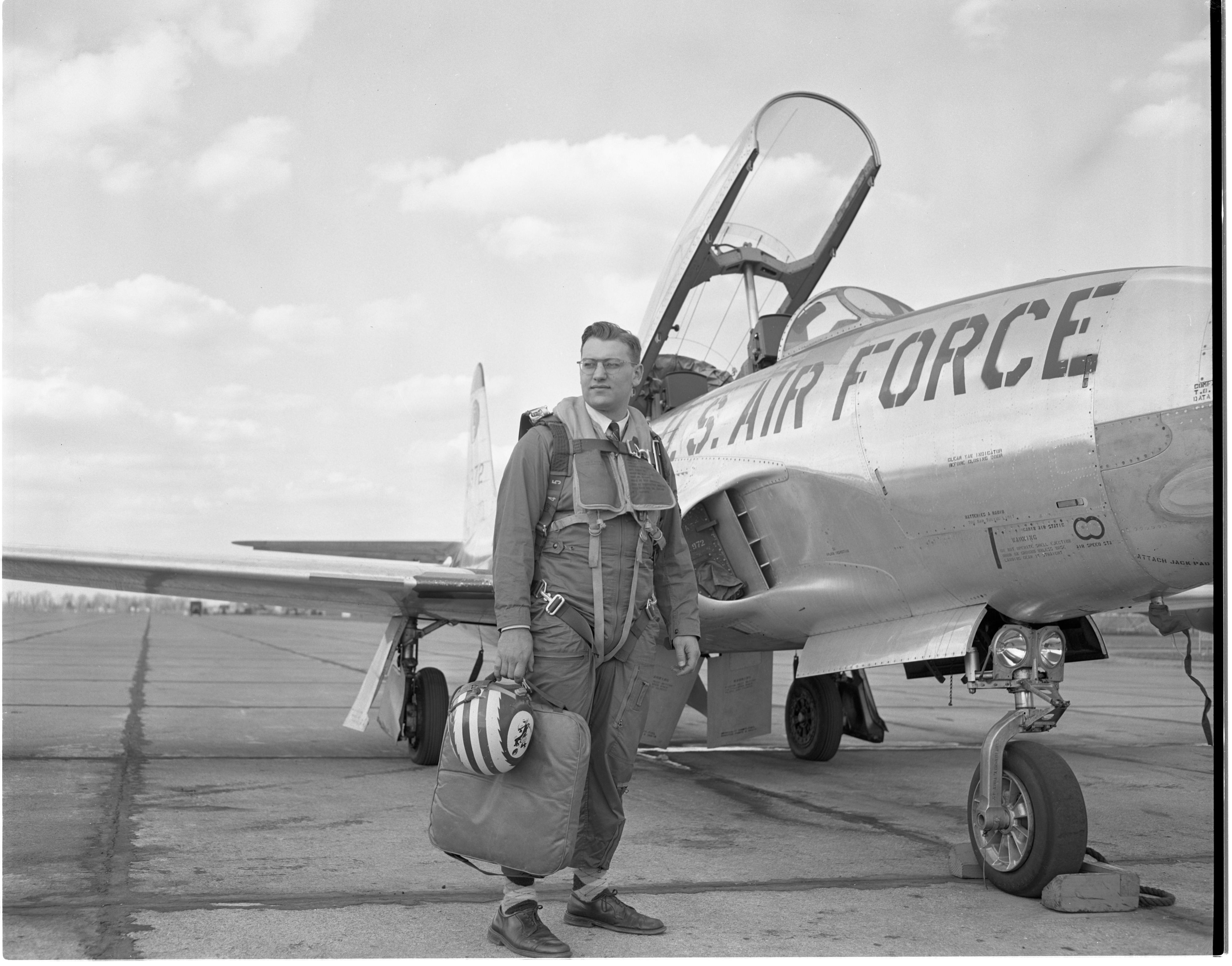 Ann Arbor News Reporter Dick Kerr Poses In Front Of The Air Force T-33 Trainer Jet He Will Take A Ride In, April 1956 image