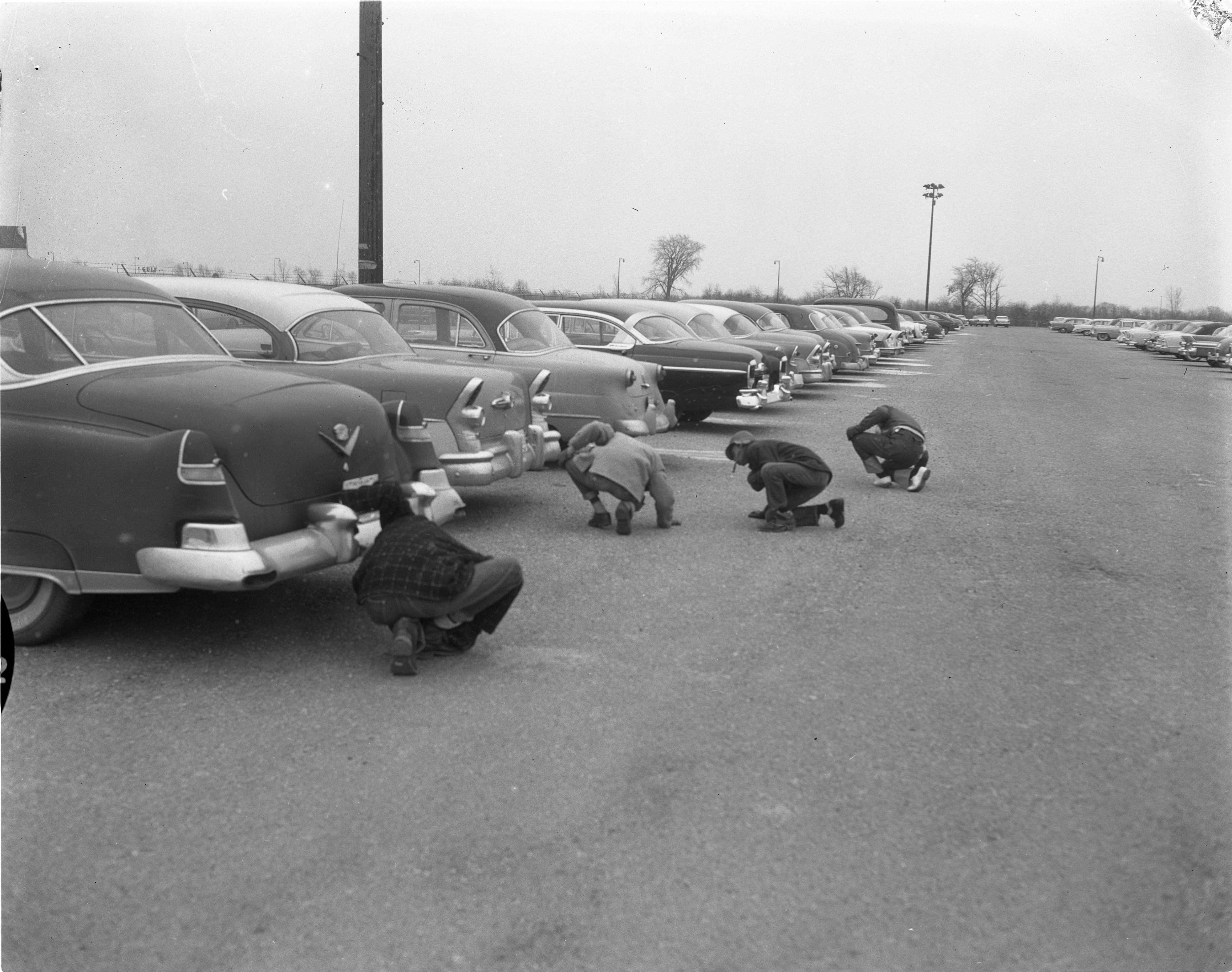 Detectives & Members Of The Willow Village Junior Deputy League Search For Clues In Willow Run Airport Murder, December 29, 1956 image