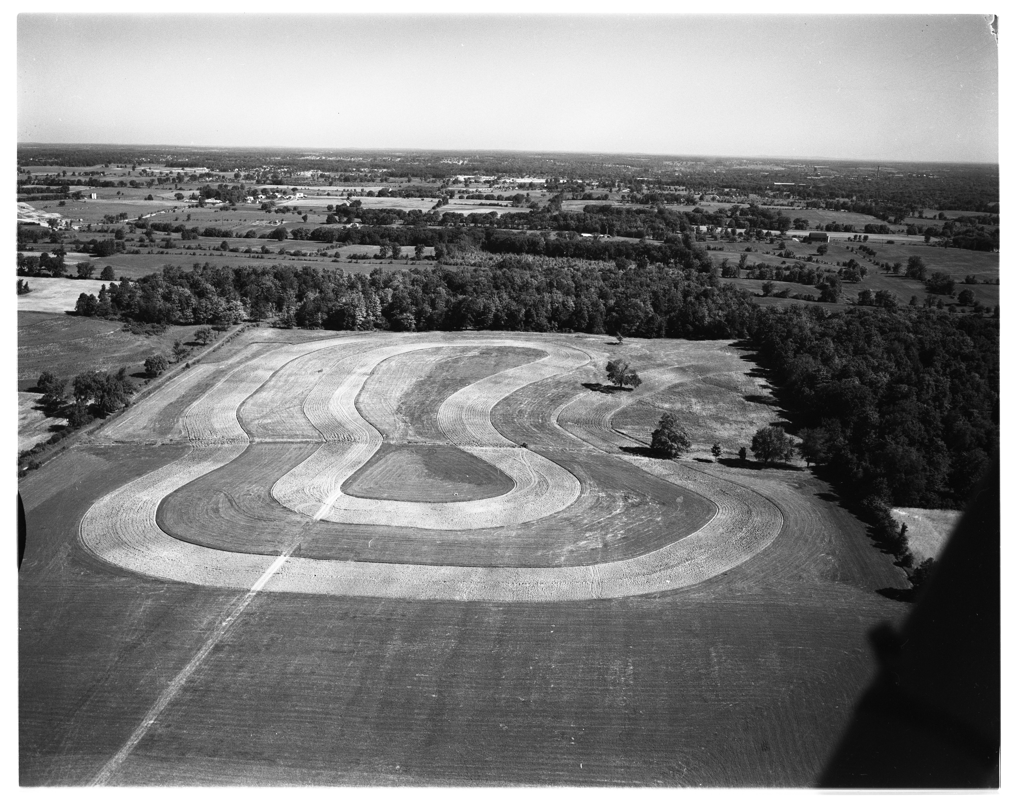 Aerial Photograph of Contour Plowing on a Farmer's Field, 1110 W. Ellsworth Rd., July 1954 image