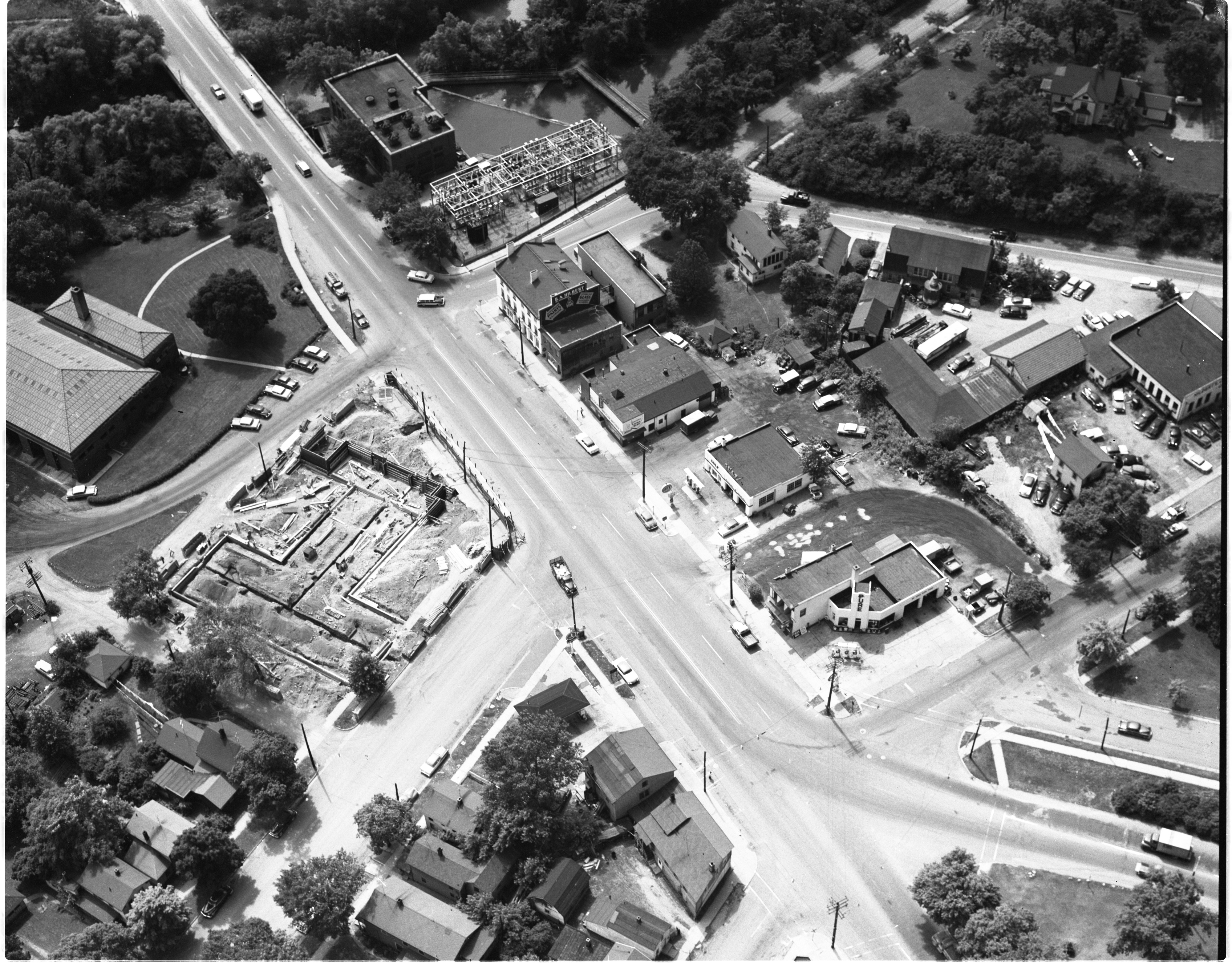 Aerial View Of University Motel Construction - Broadway Business District Between Wall And Canal Streets, July 1956 image
