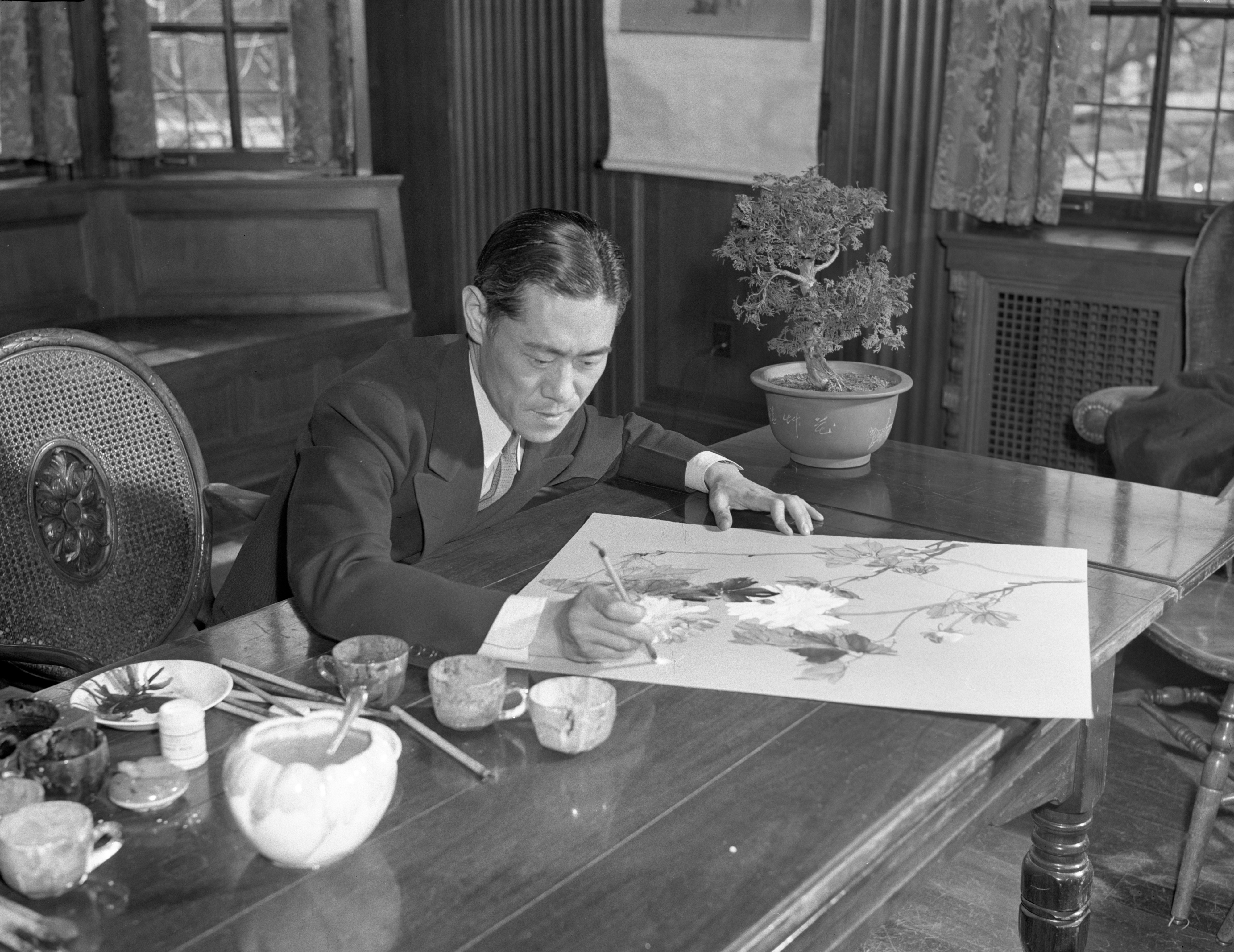 Prof. Chang Shu-Chi Completes A Painting at the Michigan League, March 1943 image