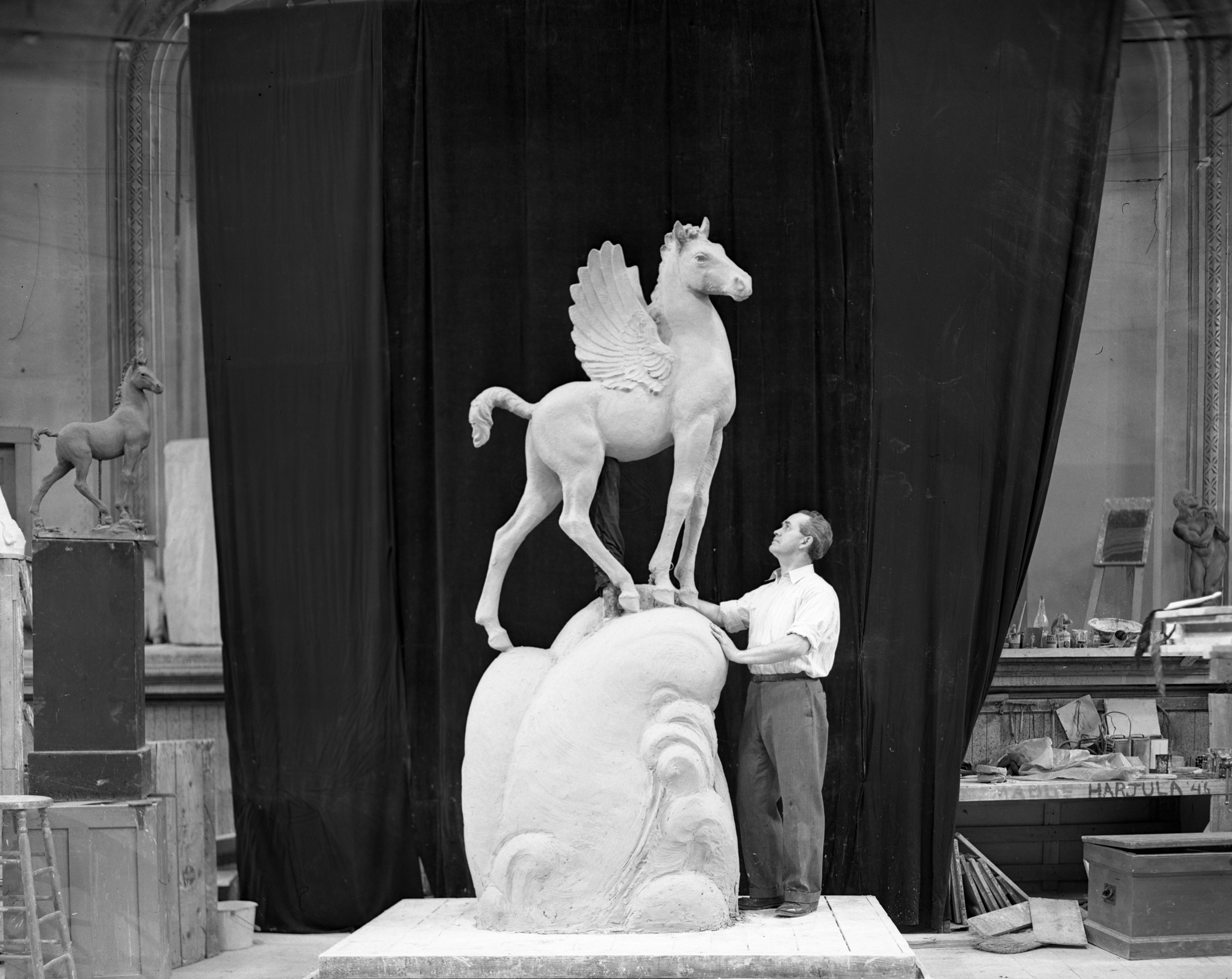 "Avard Fairbanks and Sculpture ""Colt Pegasus,"" February 1947 image"