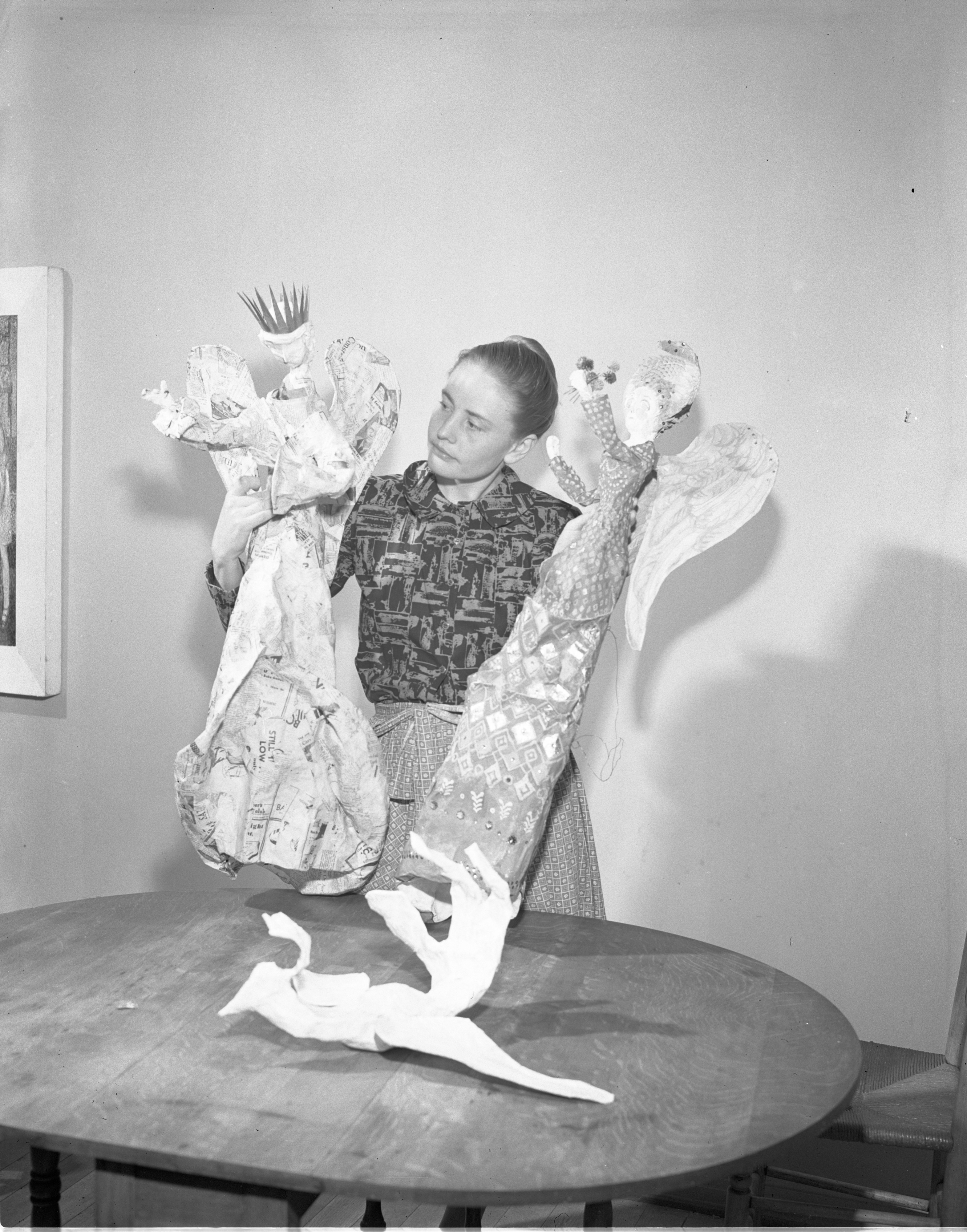 Ellen Wilt Displays Her Papier-Mâché Angels In Different Stages Of Completion, November 1950 image