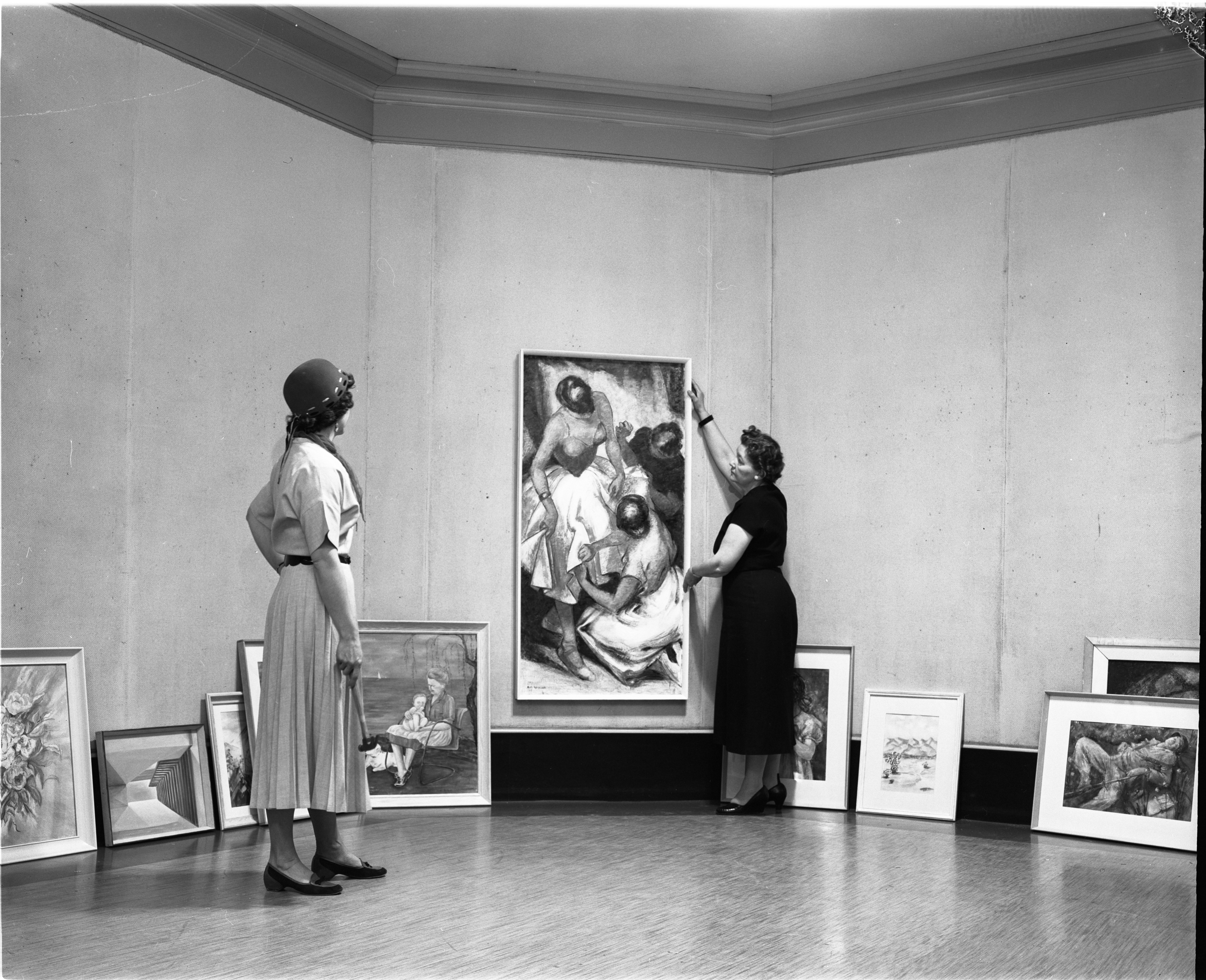 Two Women Hang Paintings At Ann Arbor Art Show, March 1956 image