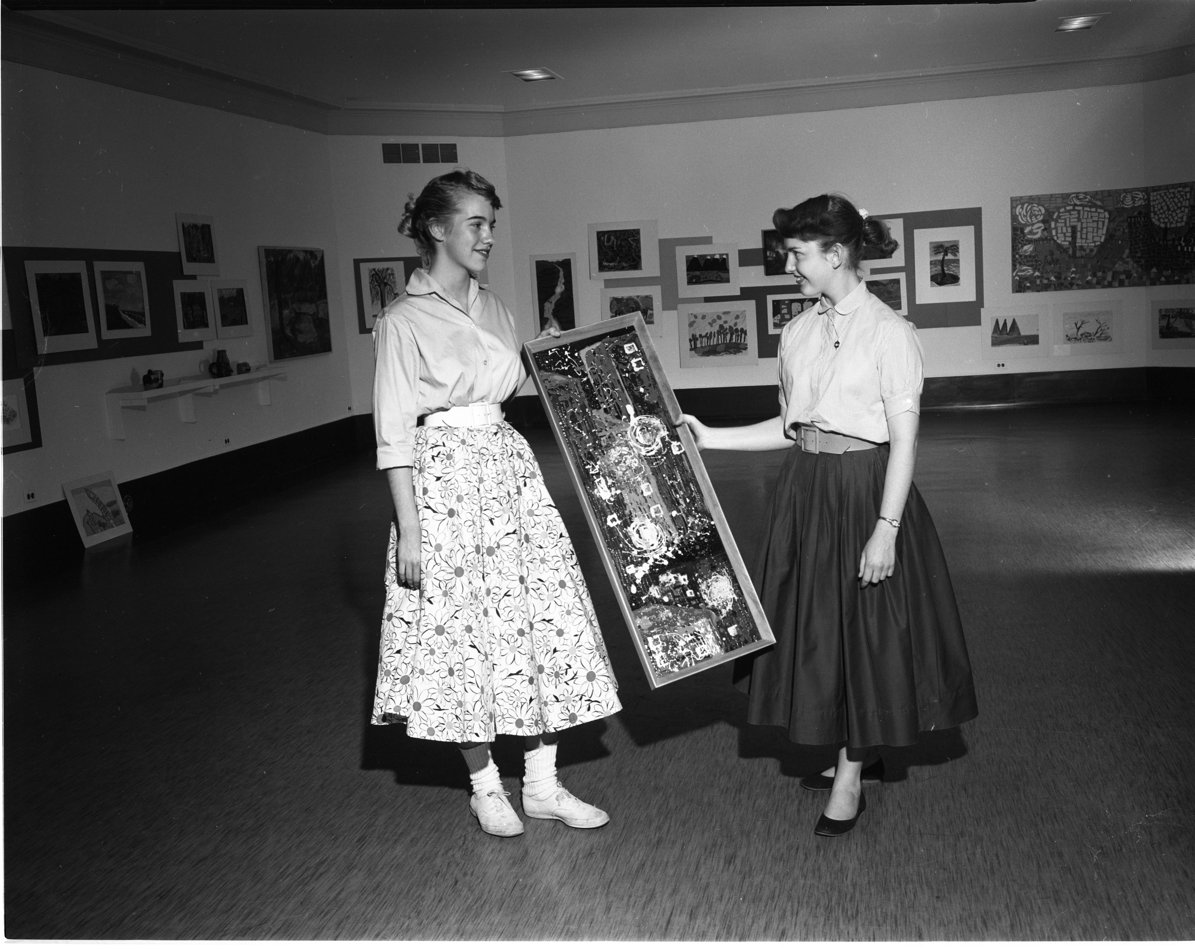 Ann Vidar and Arline Harms at the Ann Arbor Art Association's Annual Youth Exhibit, May 1957 image