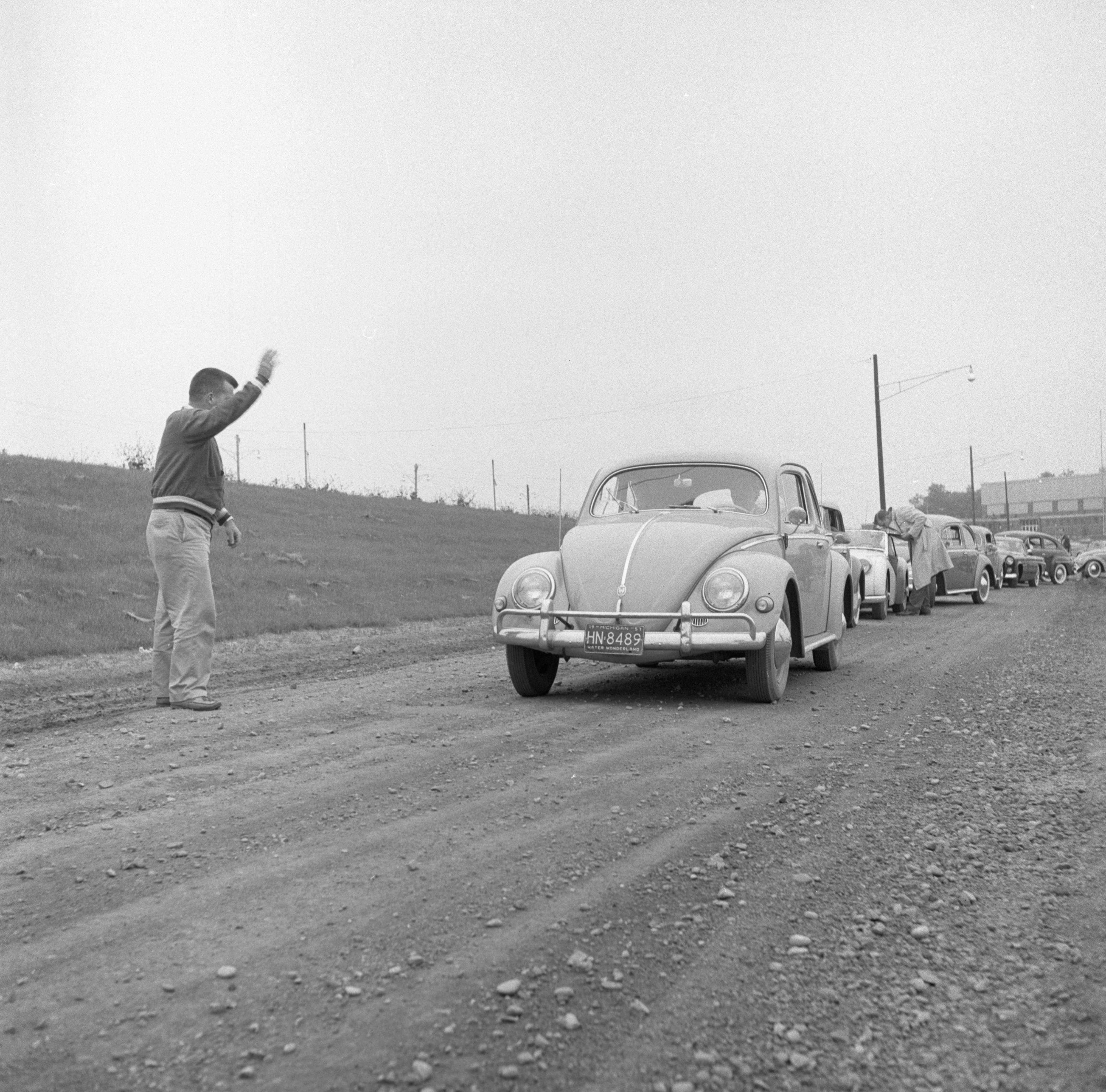 Cars Line Up At Ann Arbor High School For The Start Of A Foreign Car Road Rally, June 1957 image