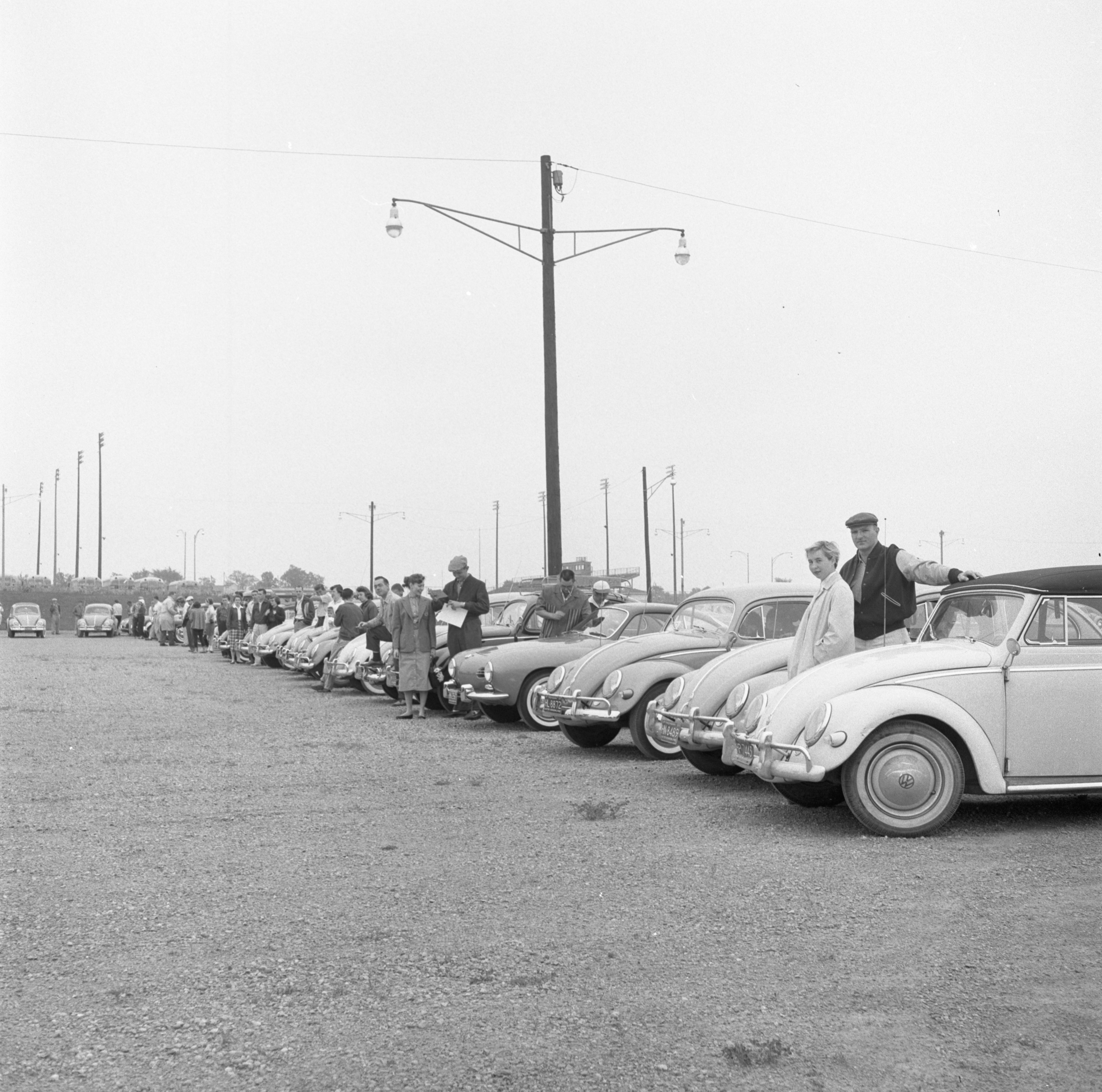 Cars & Drivers Wait In The Ann Arbor High School Lot For The Start Of A Foreign Car Road Rally, June 1957 image