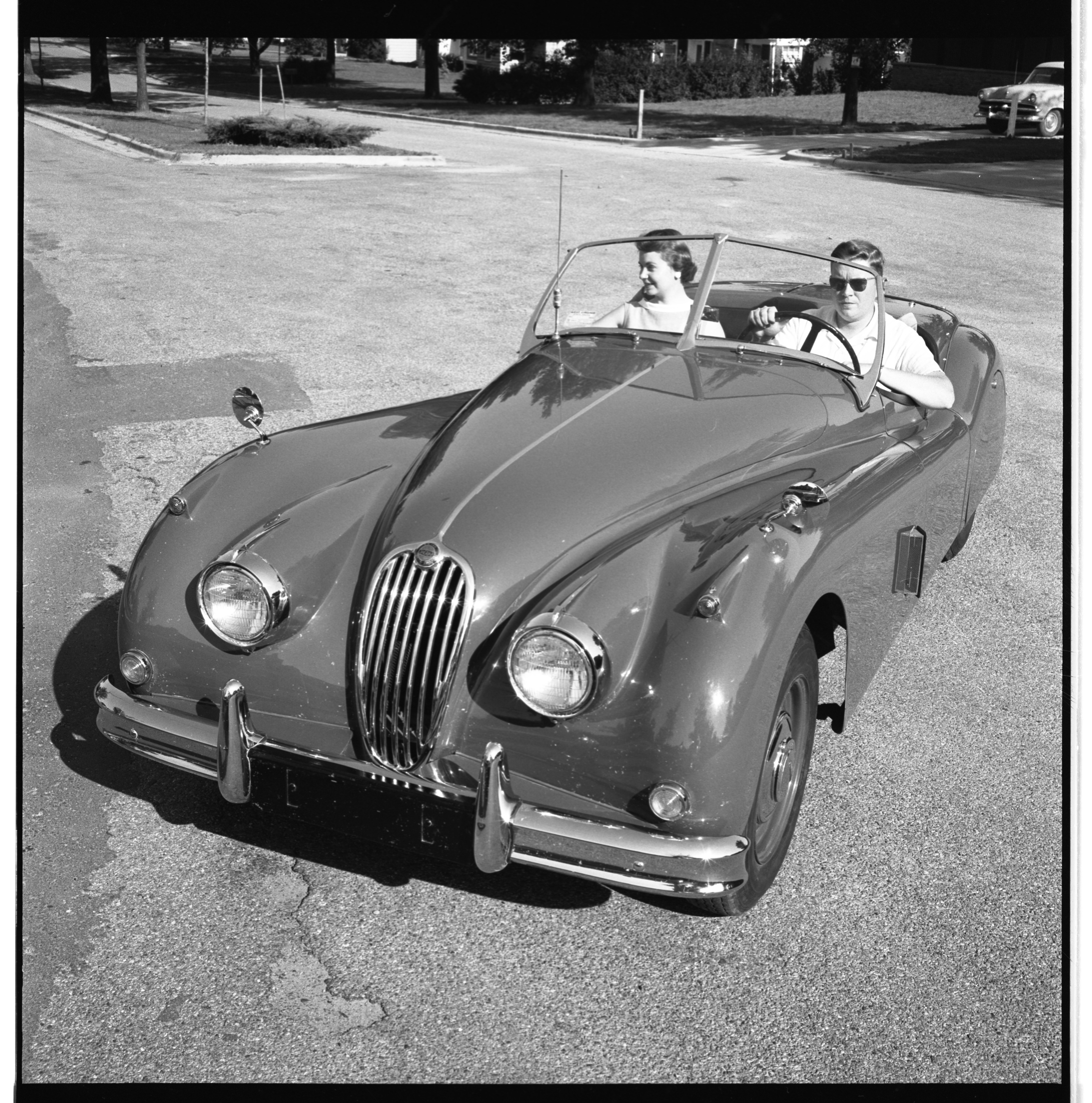 Mr. and Mrs. William T. Callaghan in their Jaguar, August 1957 image