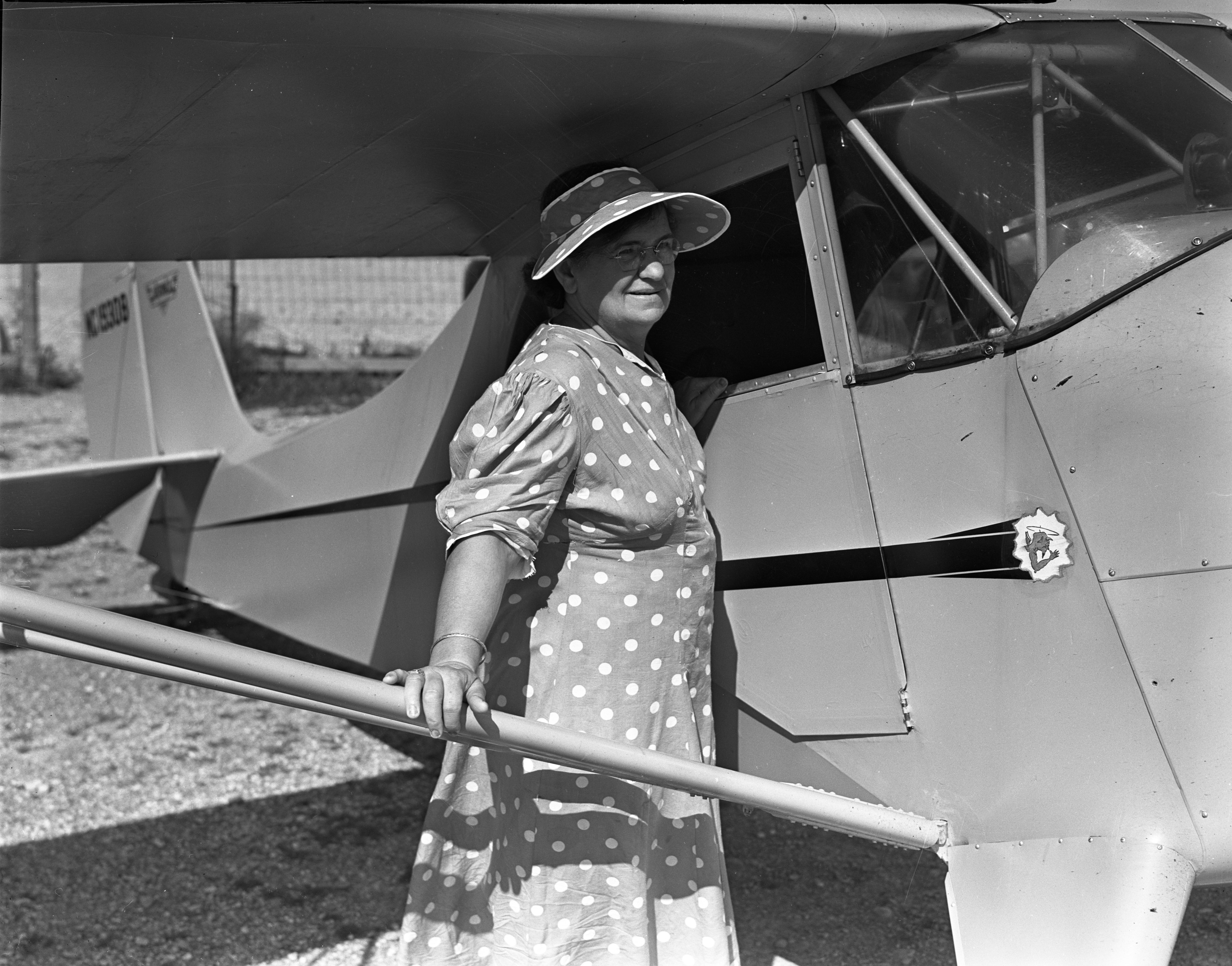 Mrs. Carl Rufus and her Cub 65 Plane image