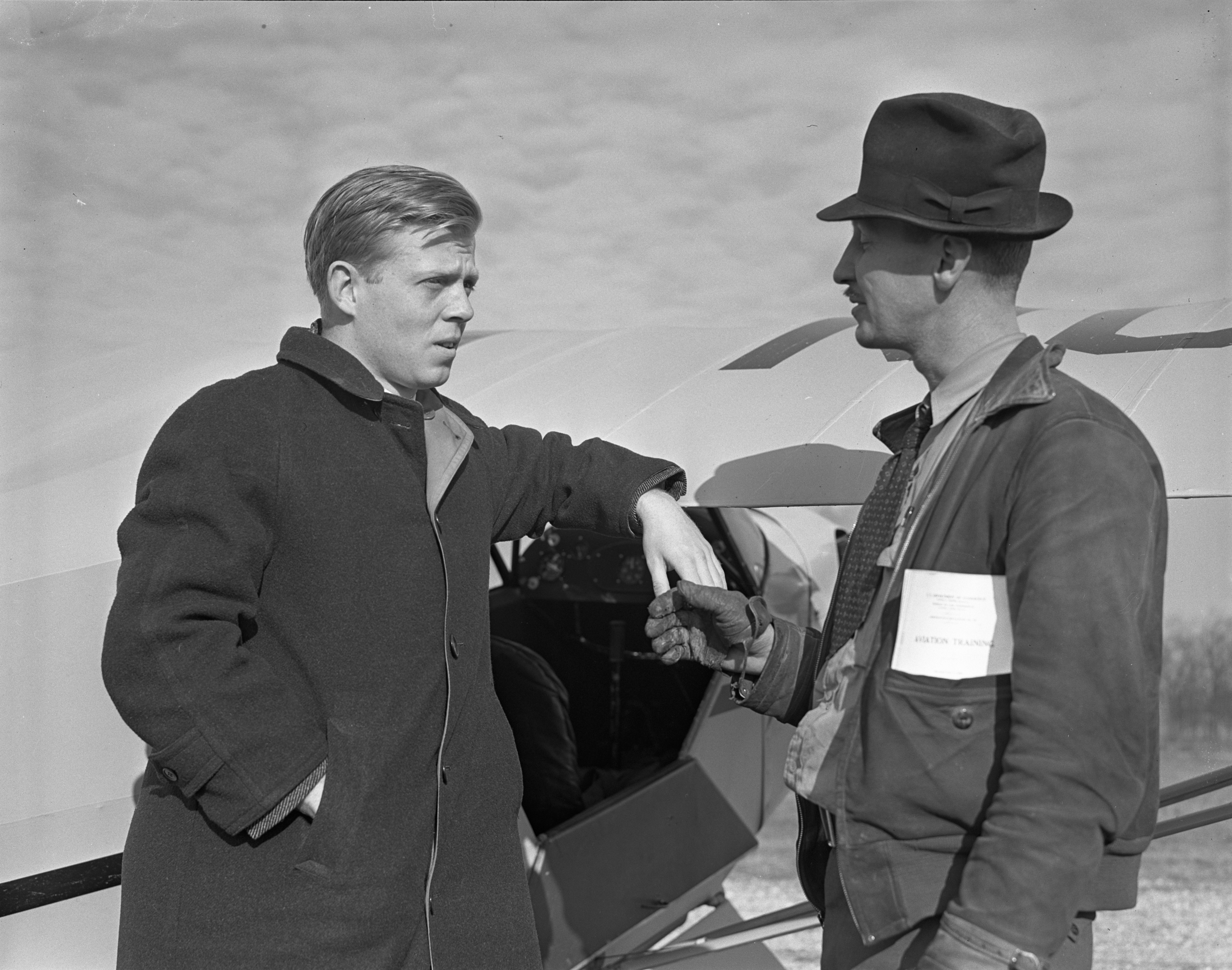Instructor George M. Downs with Donald R. Knapp, the First Student to Solo in U.S. War Preparedness Program, March, 1939 image