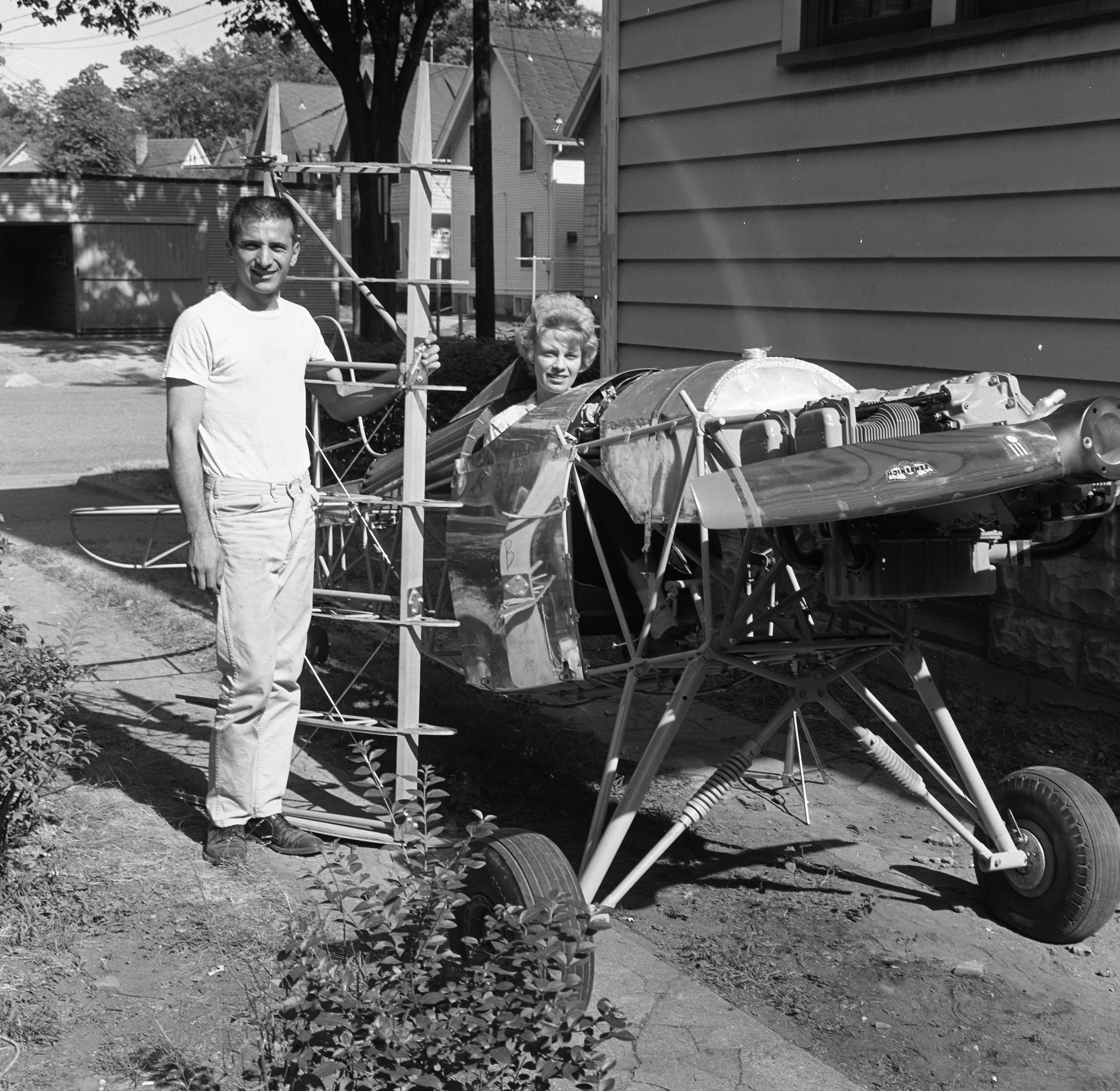 Ann and Don Pellegreno of Hill Street With Biplane Built for Acrobatic Flying, July 1963 image