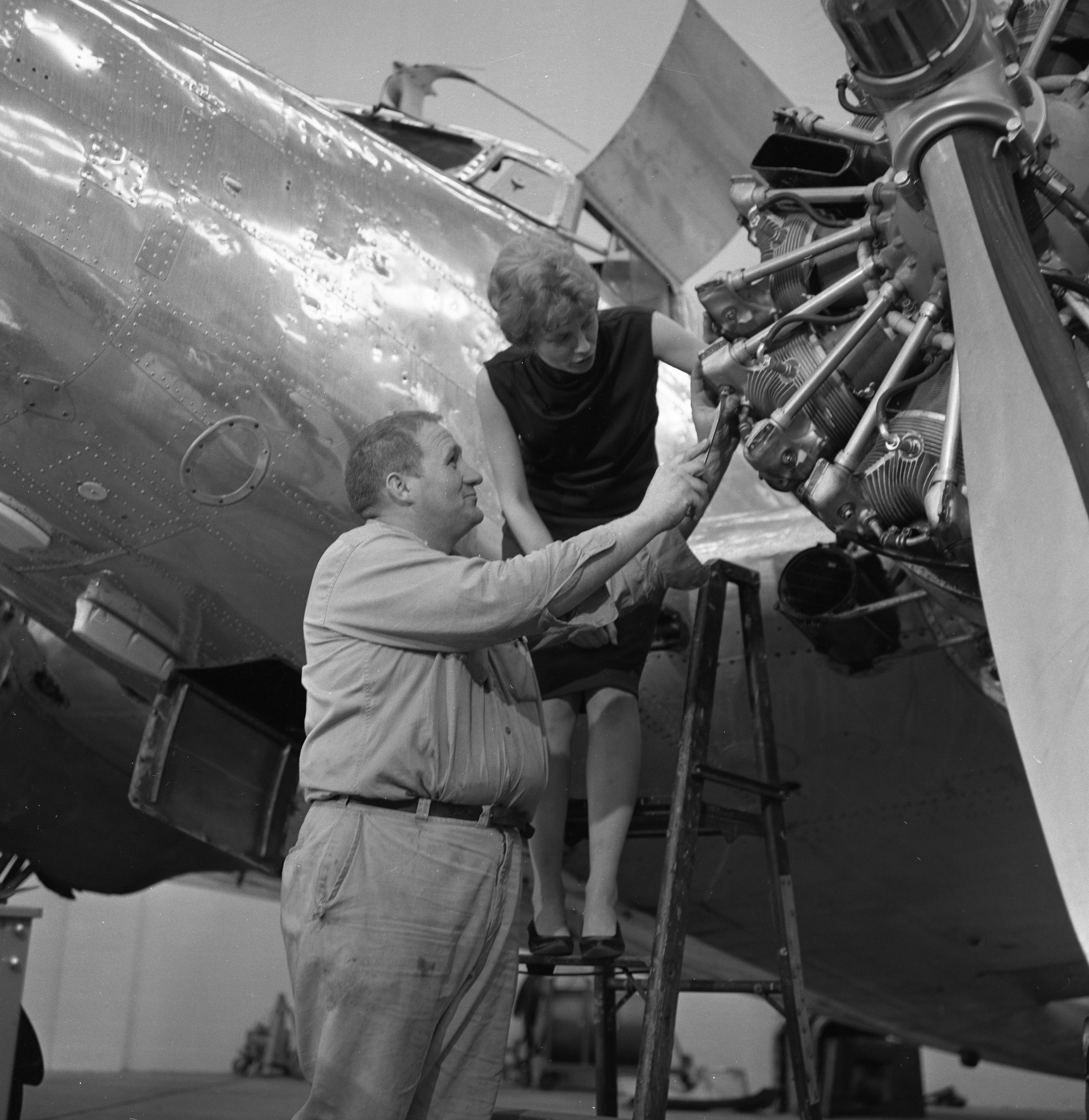 Ann Pellegreno and Lee Koepke Check Propellers of 1937-Vintage Plane for Amelia Earhart Commemorative Flight, May 1967 image