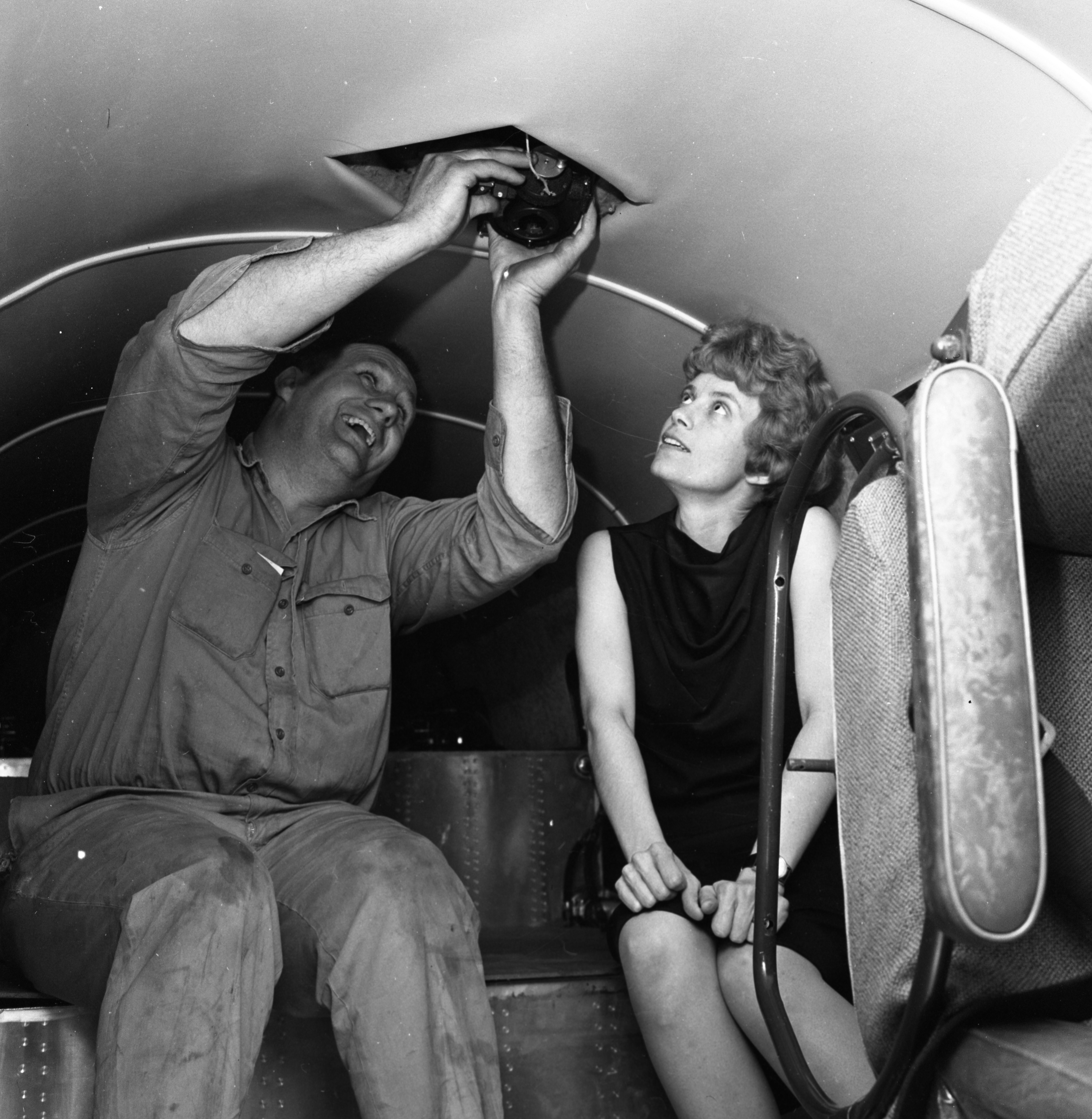 Pilot Ann Pellegreno and Mechanic Lee Koepke Check 1937-Vintage Plane for Amelia Earhart Commemorative Flight, May 1967 image