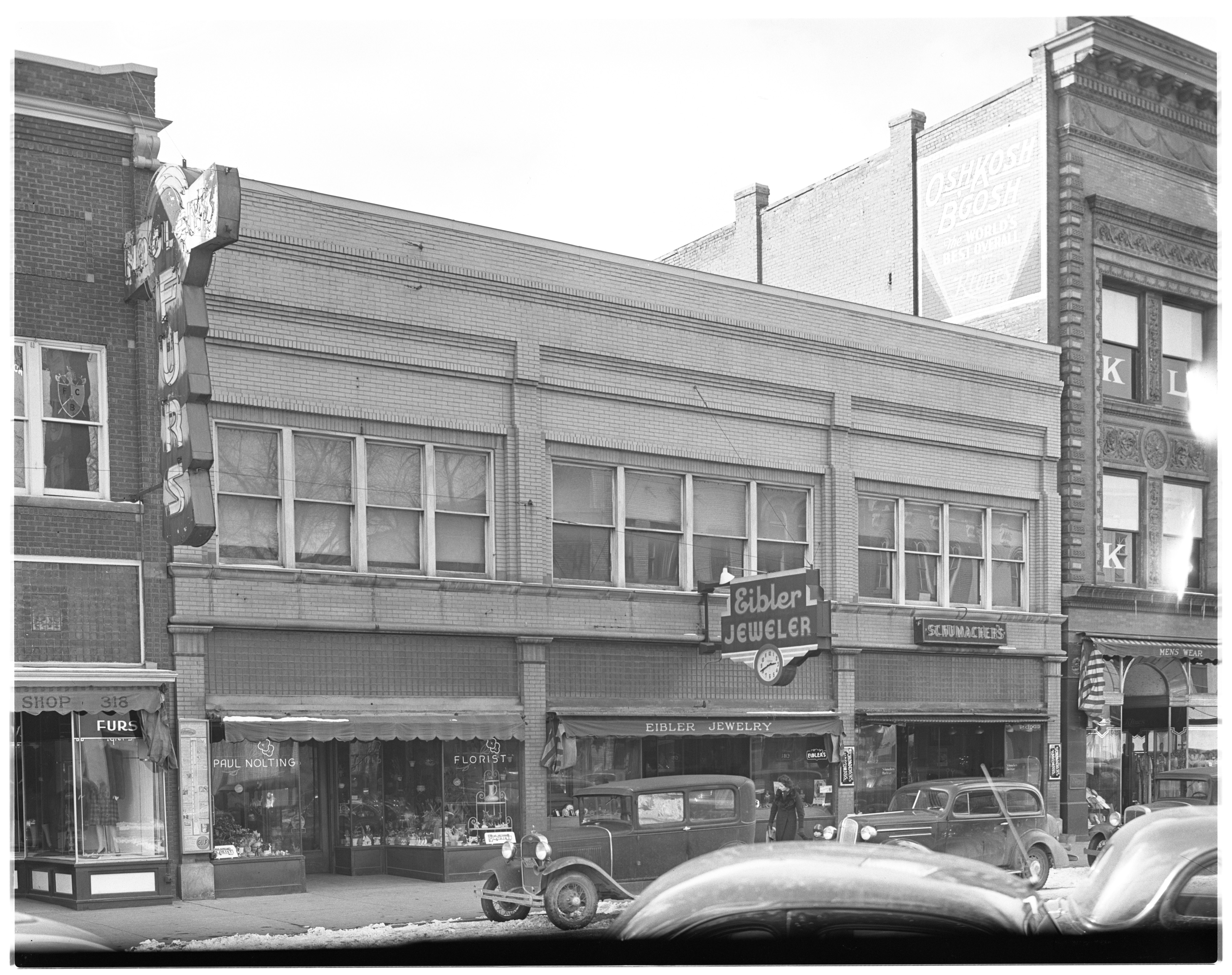 Schumacher Hardware, Eibler Jeweler, and Paul Nolting Florist,  S Main St, February 1939 image