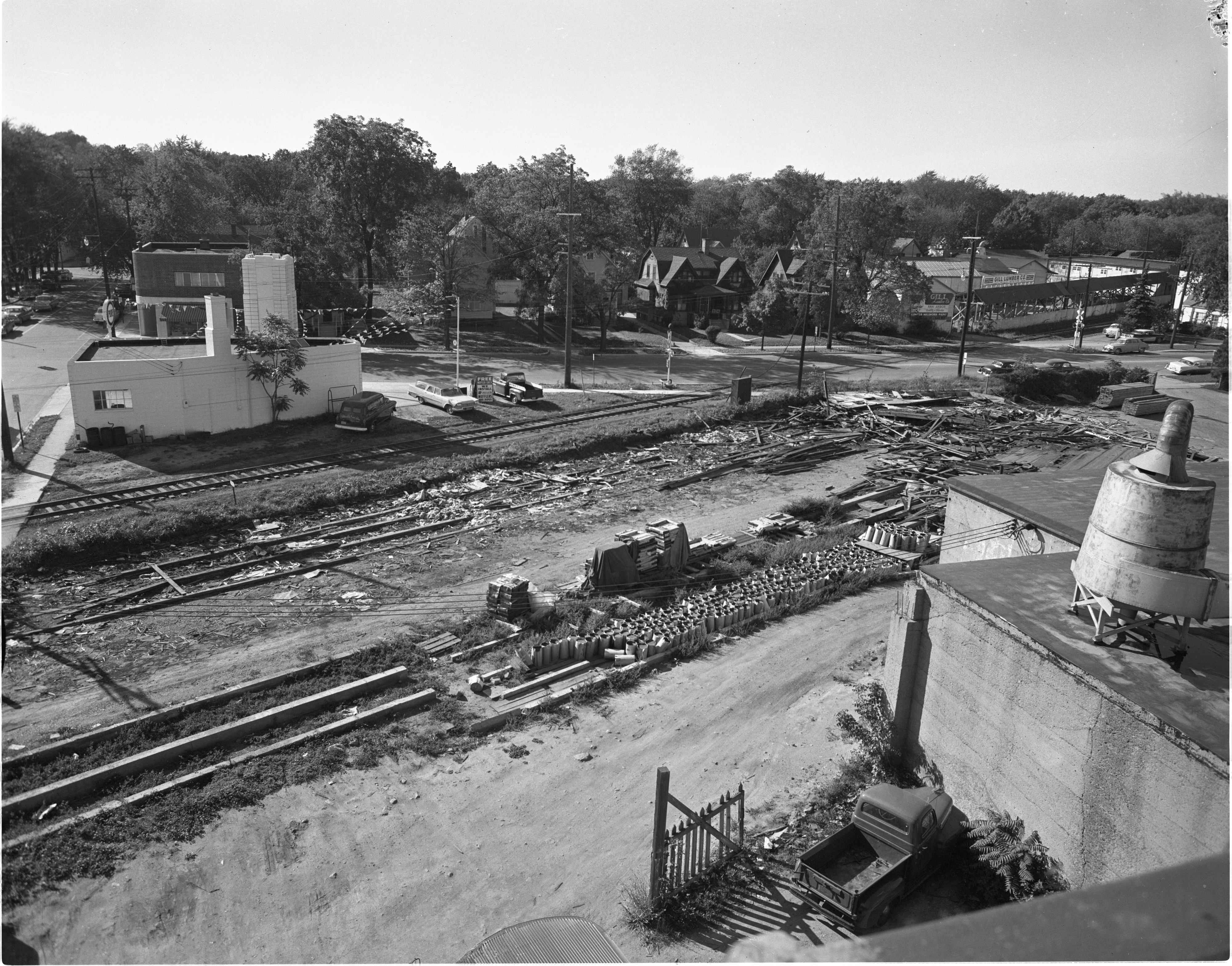 Old Lumber Facilities Along Railroad Tracks Demolished - Main / Madison Intersection, October 1958 image
