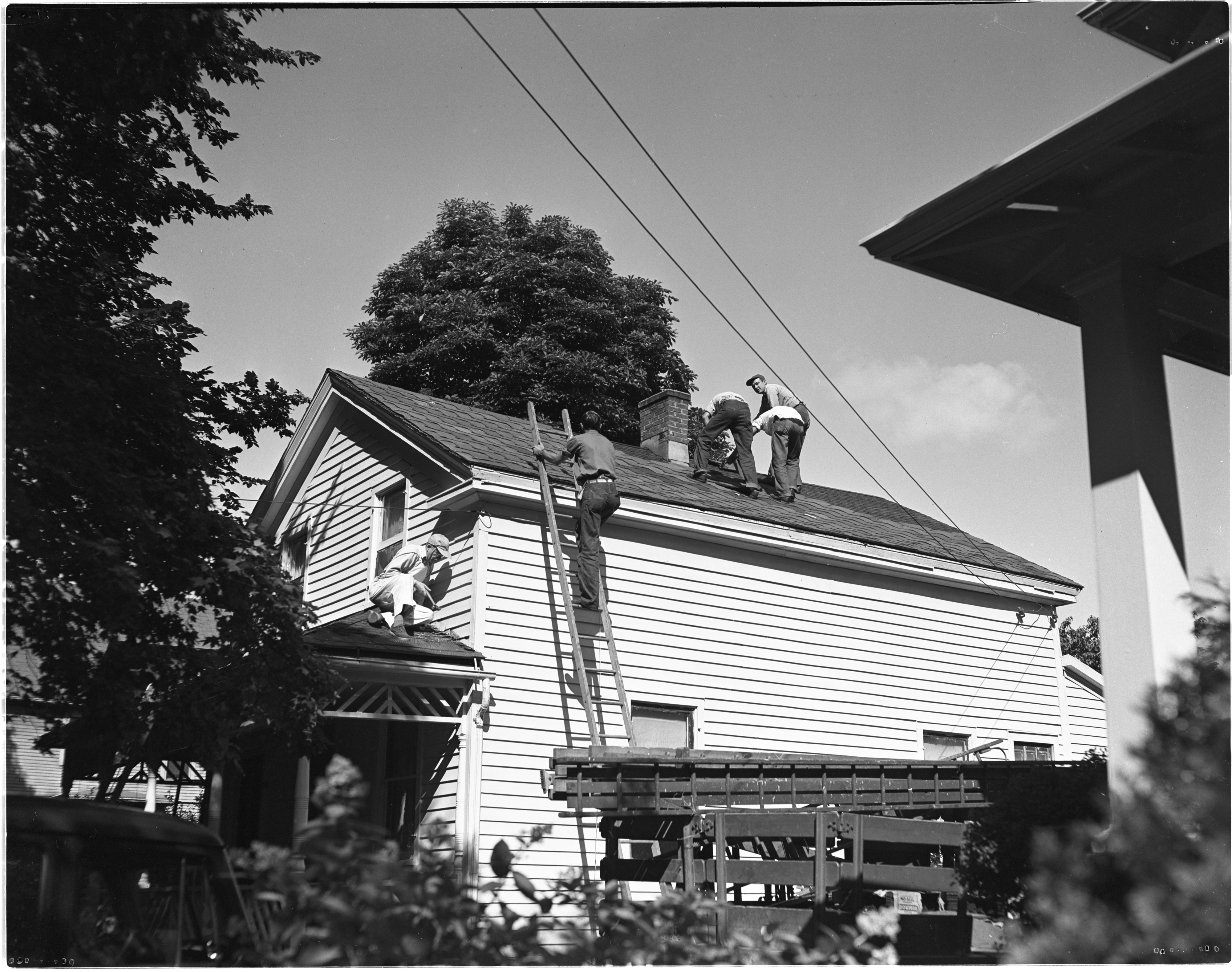 Huron Valley Roofing Company Works On Home For Hungarian Refugees, August 1950 image