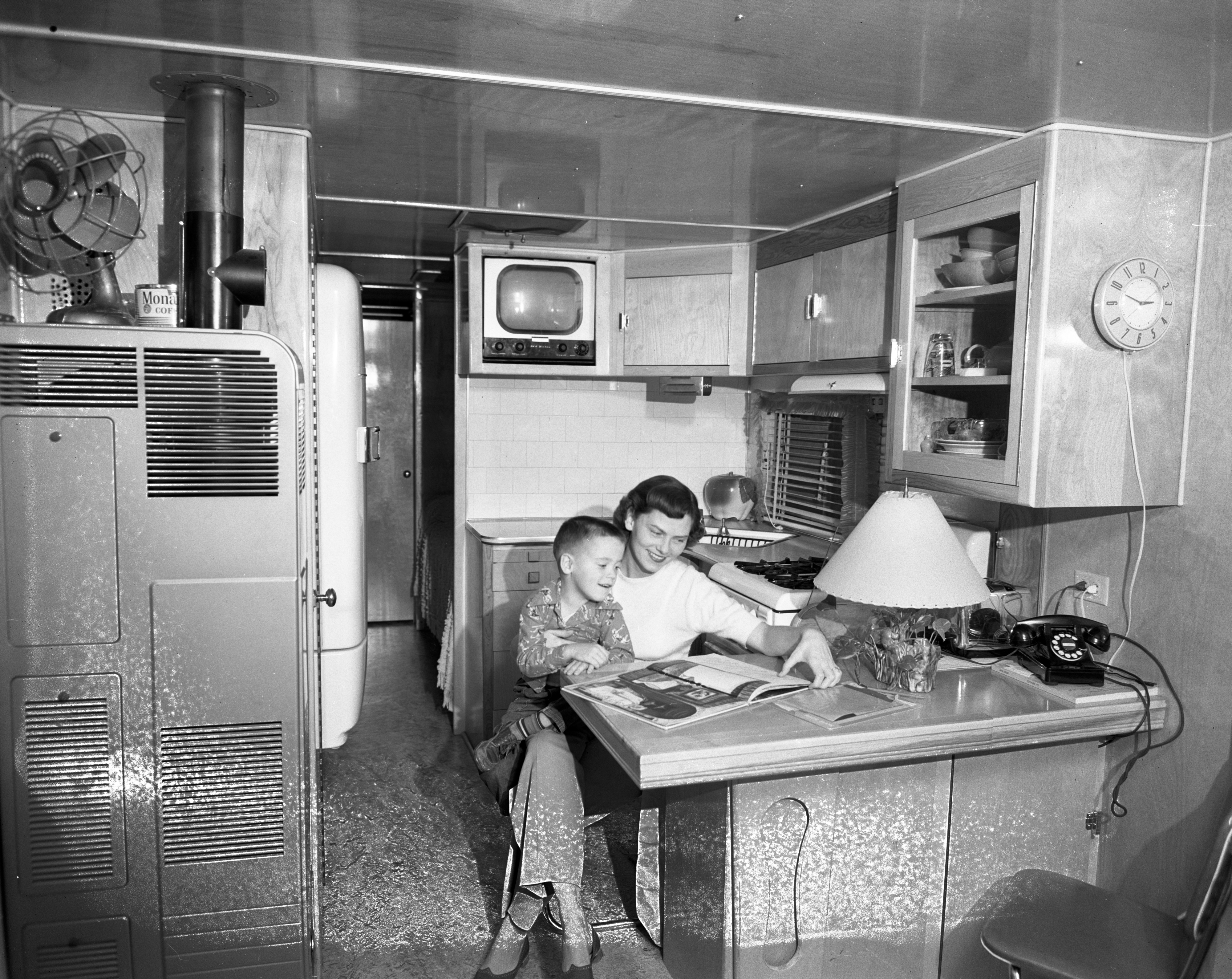 Mrs. Paul T. Pohly and her son Richard, in their trailer home in Sunnyside Trailer Park on Packard, November 1951 image