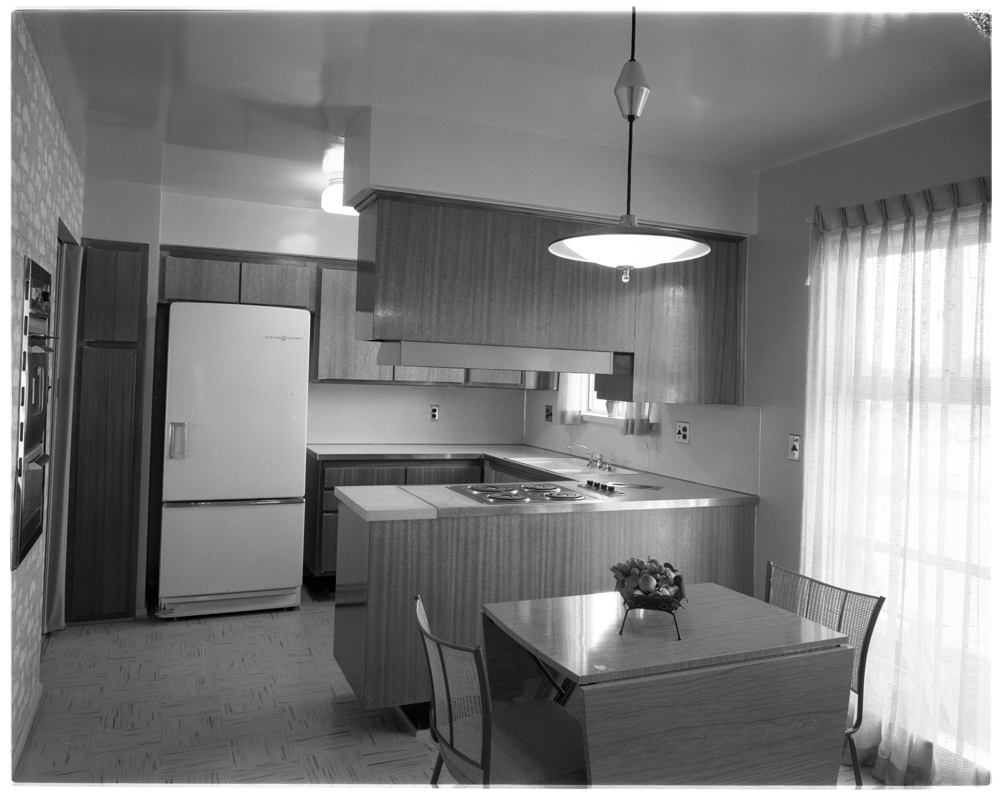 "Kitchen and Dining Area in Ann Arbor Woods ""Senator"" Model Home, September 1956 image"