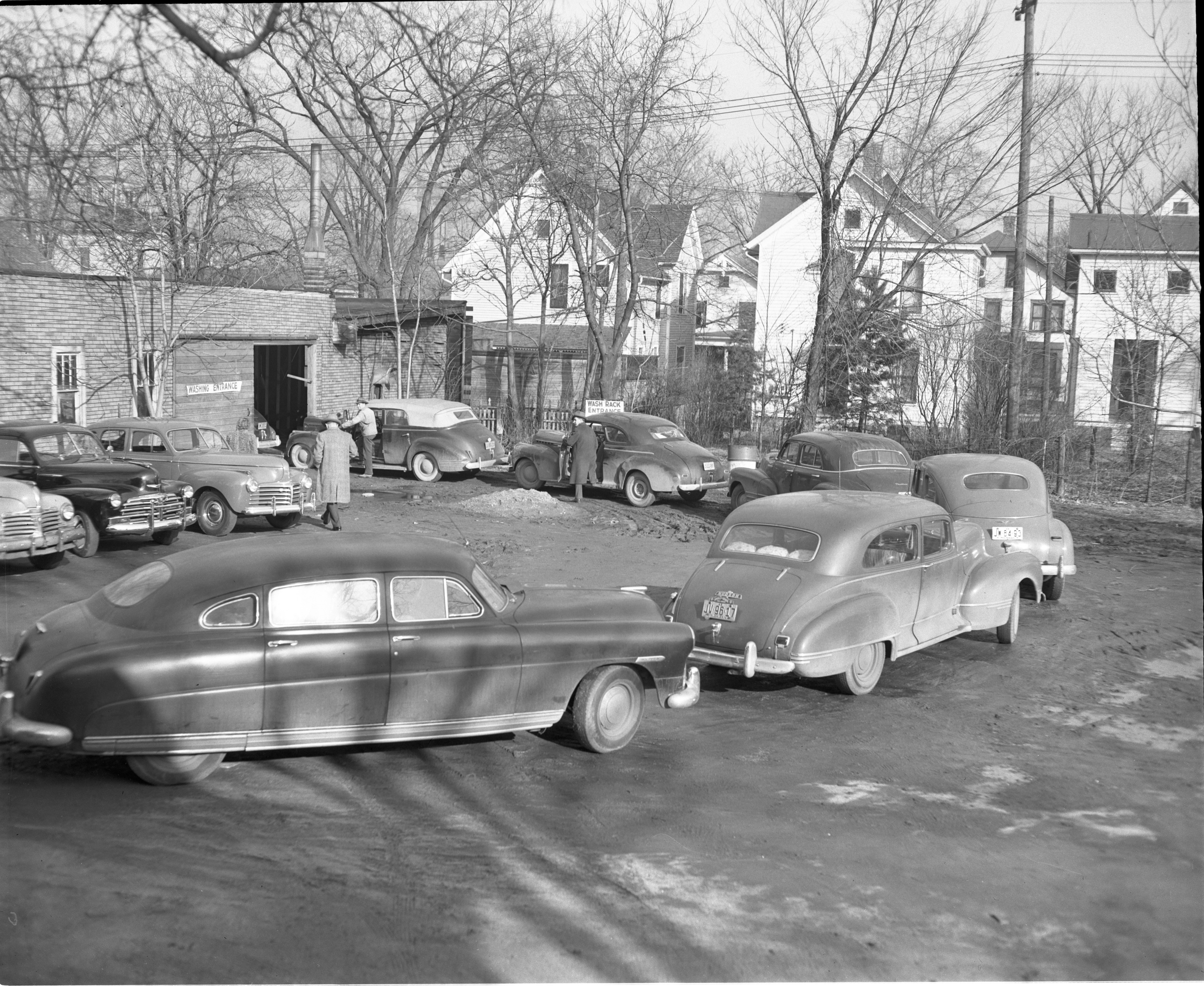 Cars Wait In Line Outside Speede Auto Wash, February 1949 image