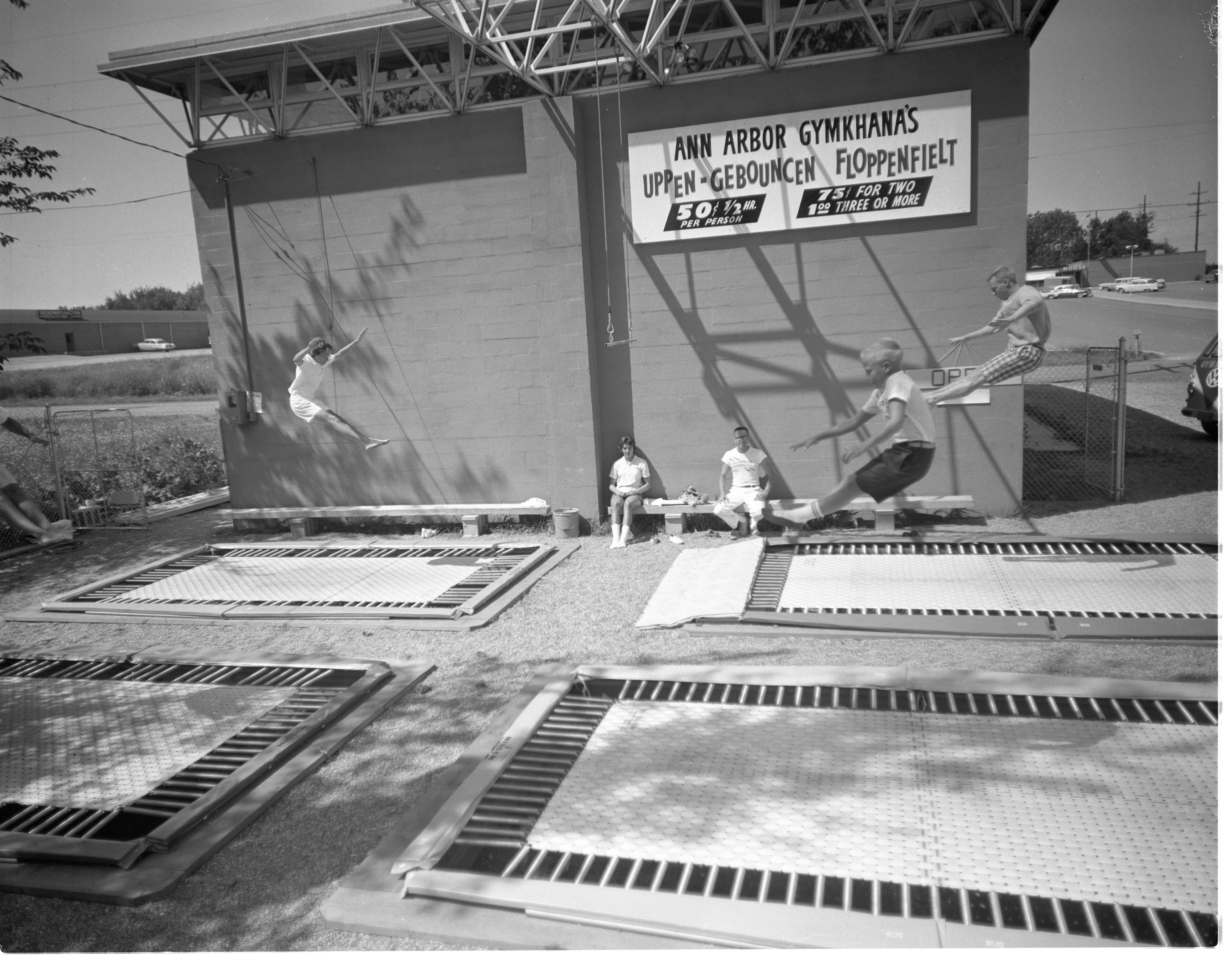 Children Use The Outdoor Trampolines At Ann Arbor Gymkhana, August 1960 image