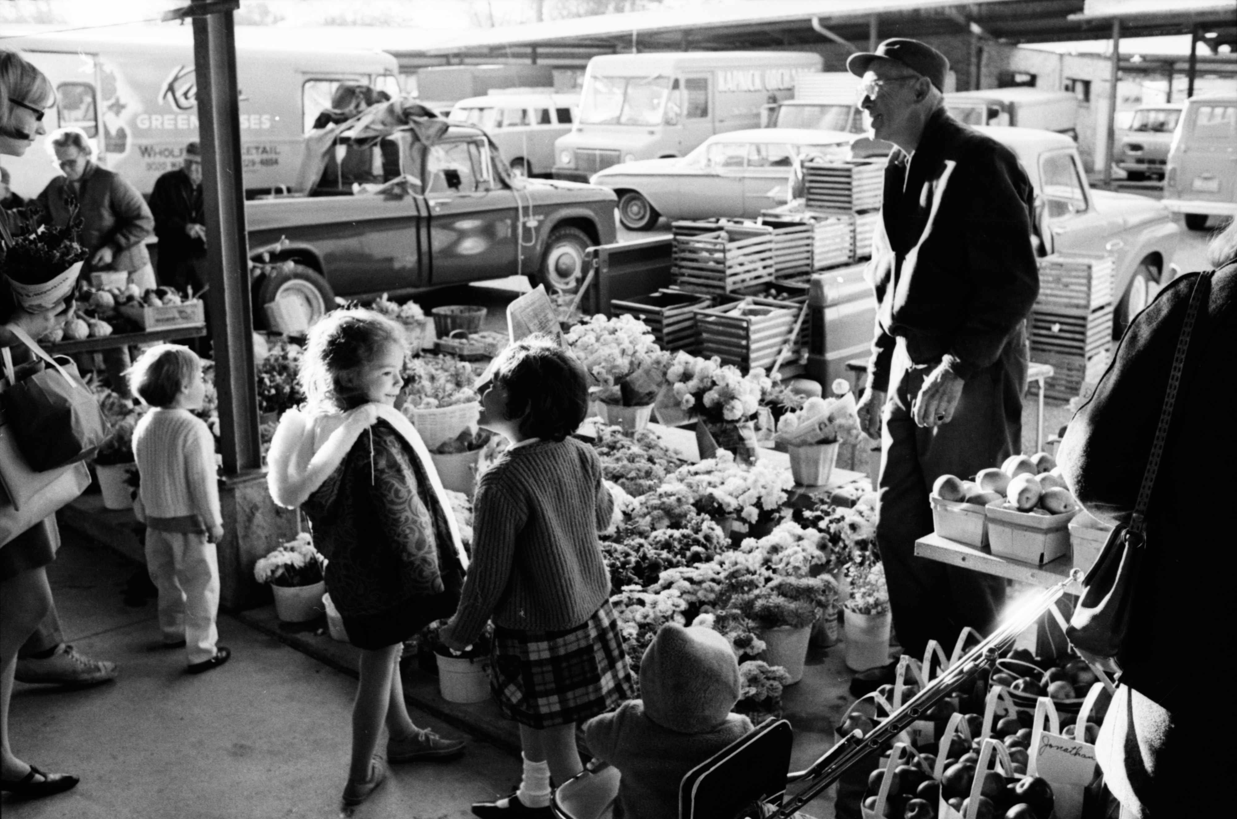 Kids Enjoying A Flower Stall at the Ann Arbor Farmers Market, October 1968 image