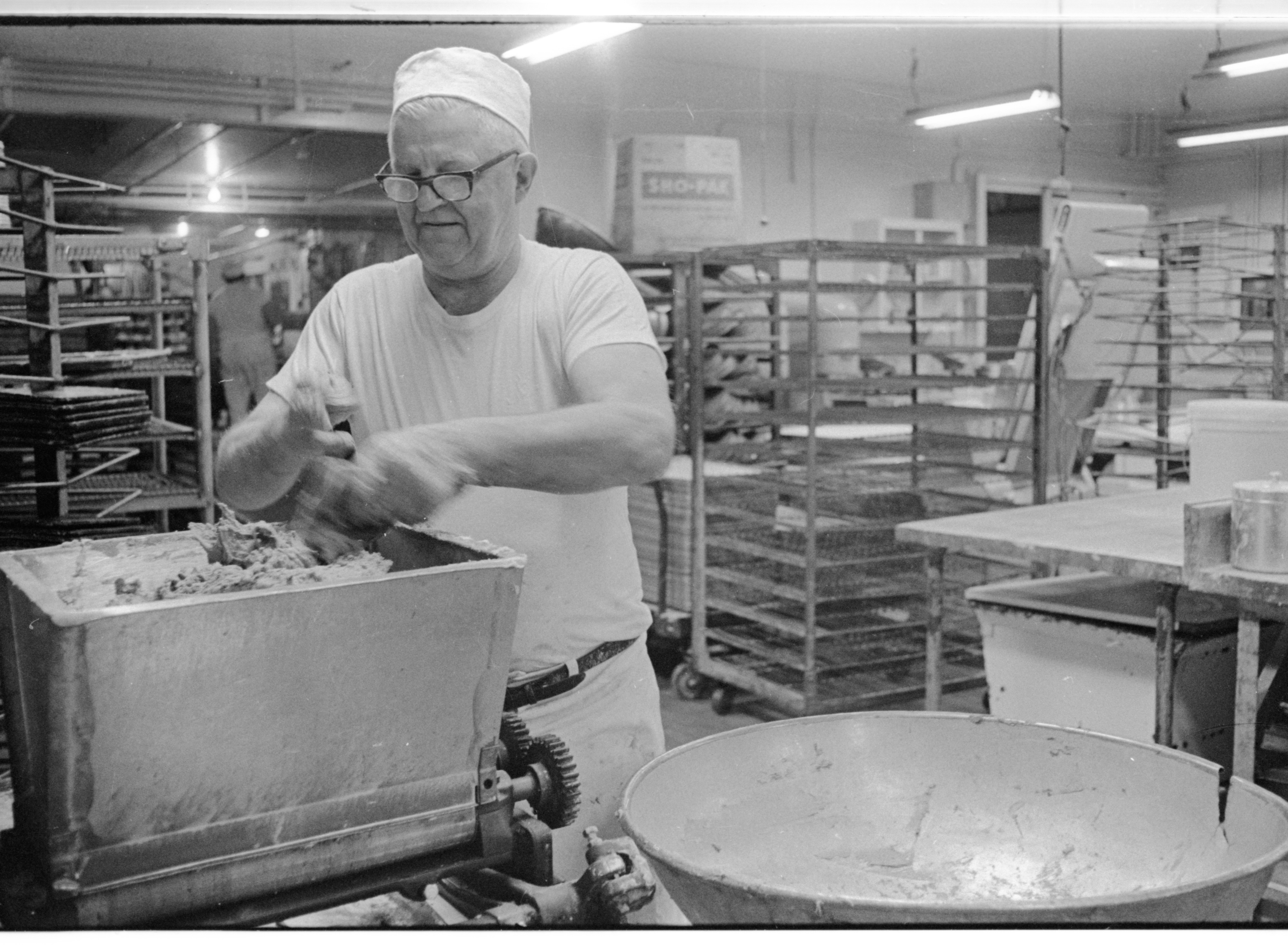 Clifford Hedlund Battles With the Cookie Dough at Quality Bakery, April 1974 image