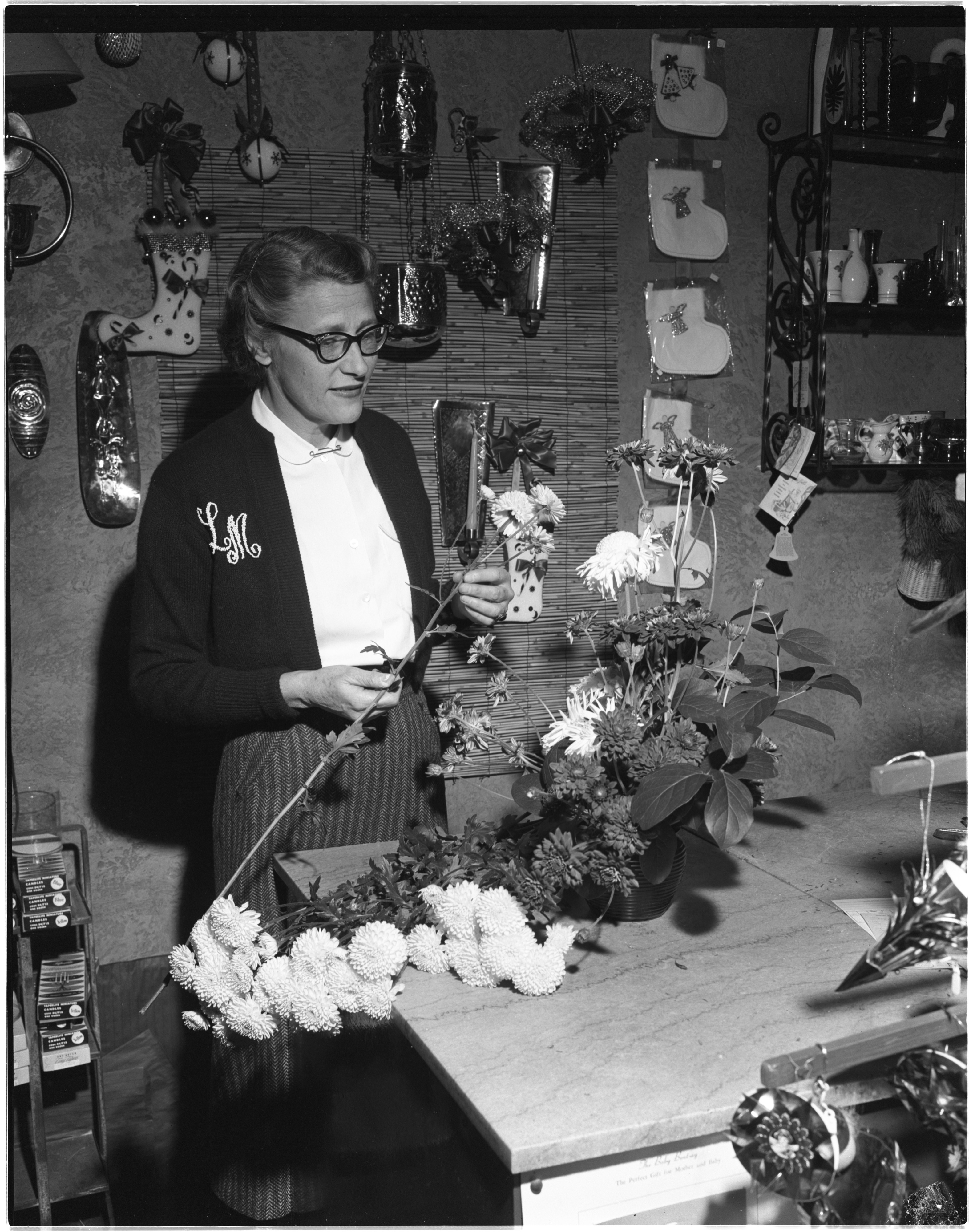 Louise Meyer Arranges Flowers In Her Shop, December 1956 image