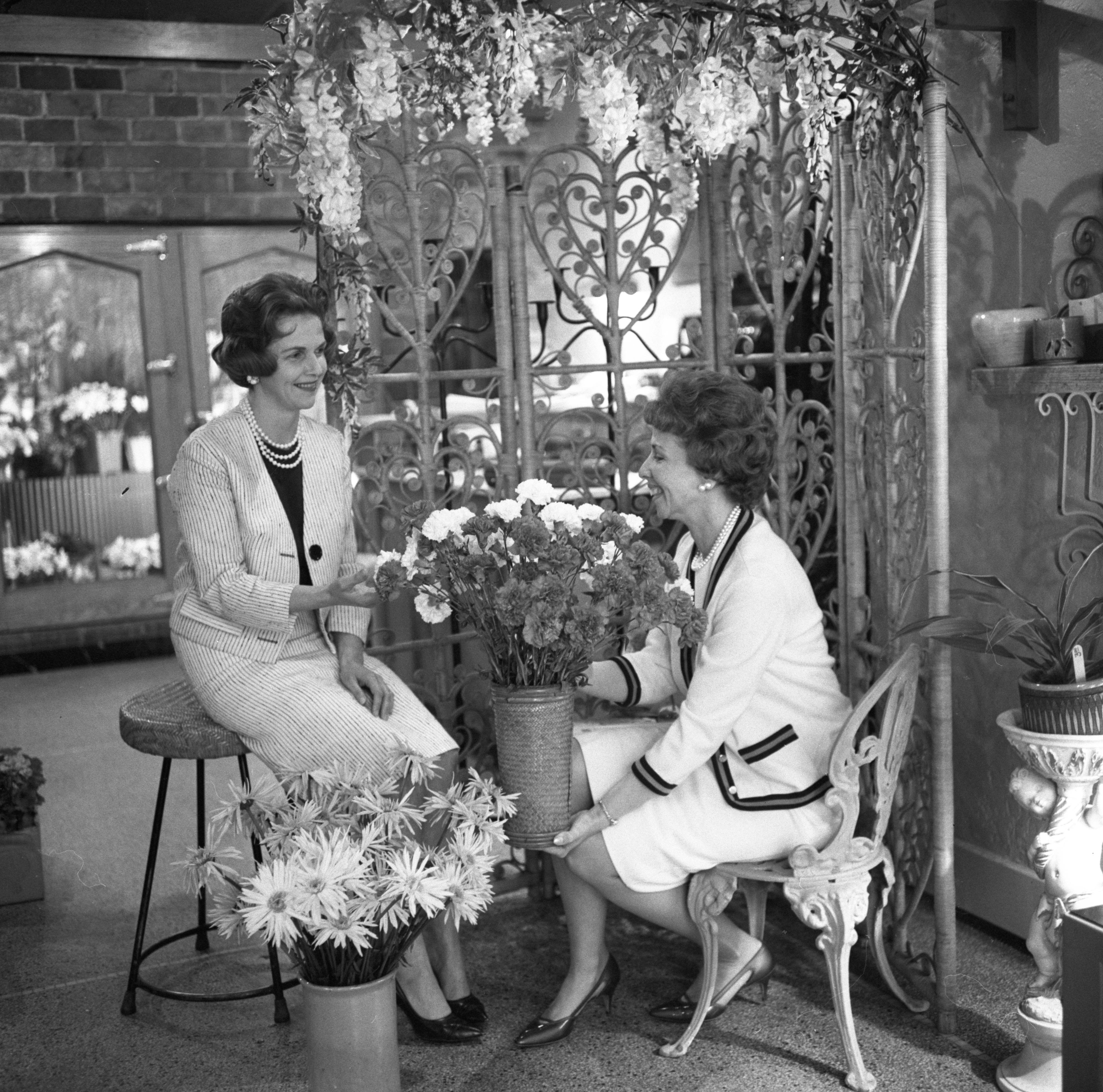 Lorraine Aquinto & Mrs. Paul Johnson Select Flowers At Goodhews For A Cotillion Club Party, May 1964 image