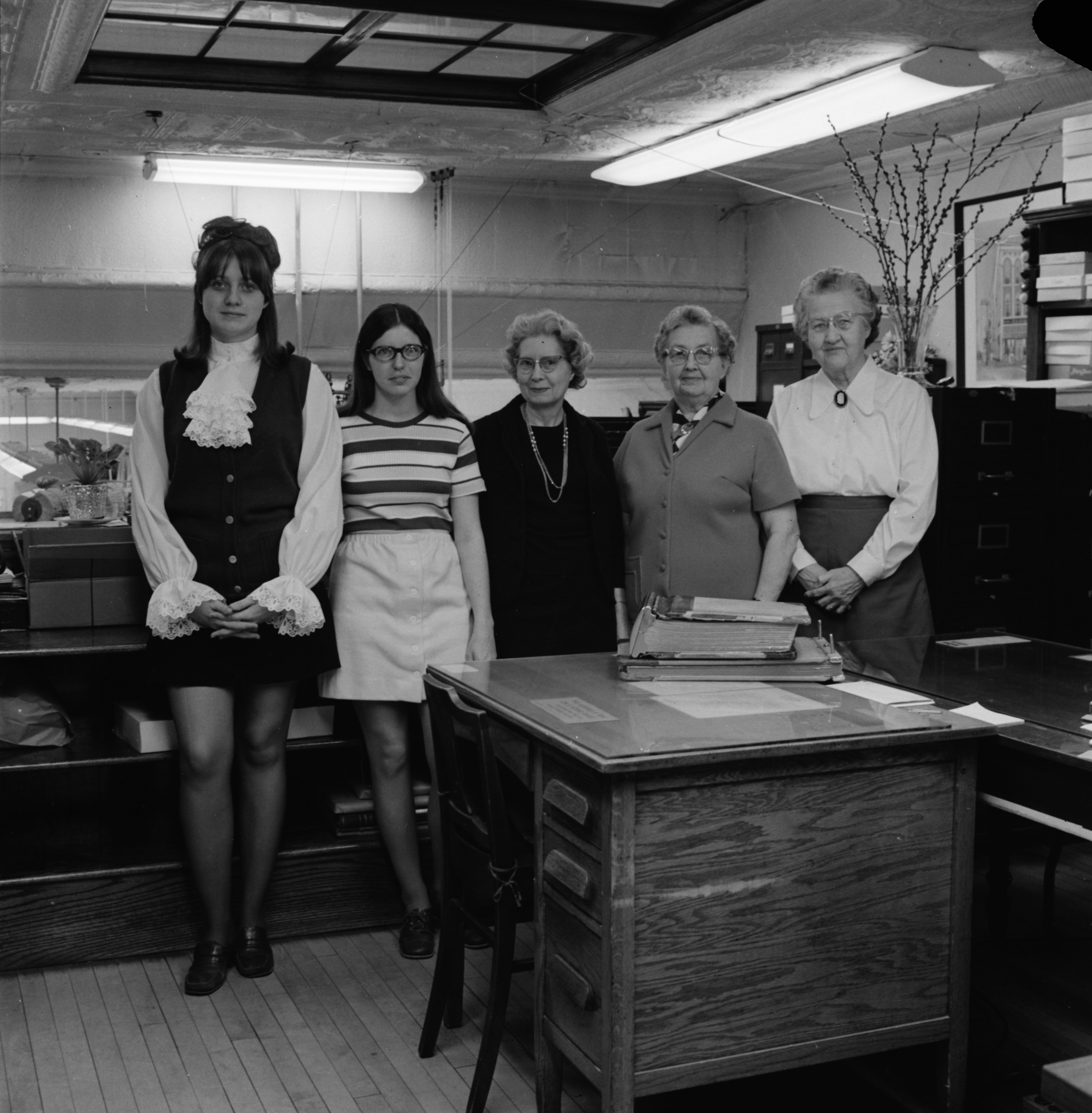 Office staff pose for B. E. Muehlig, Inc.'s 60th Anniversary advertisement, March 1971 image