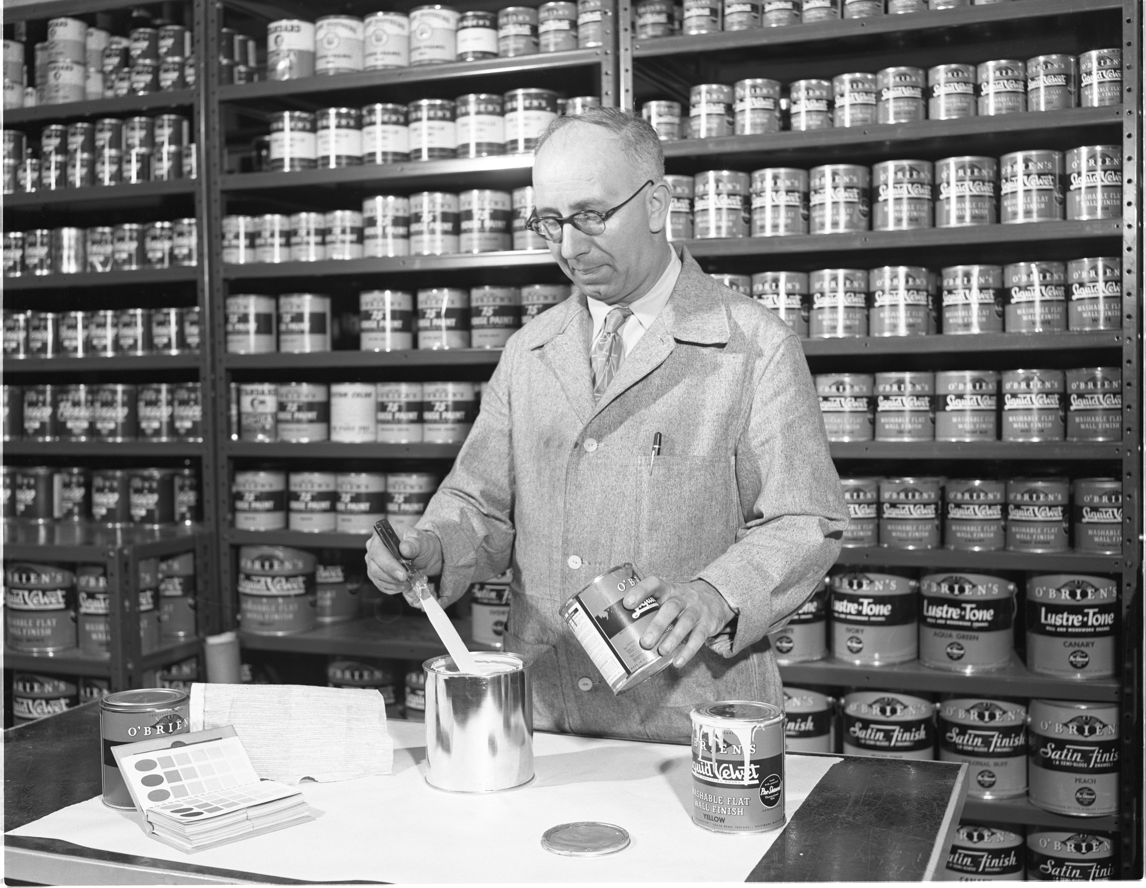 An Employee Of The Paint Pot Mixes Paint, April 1952 image