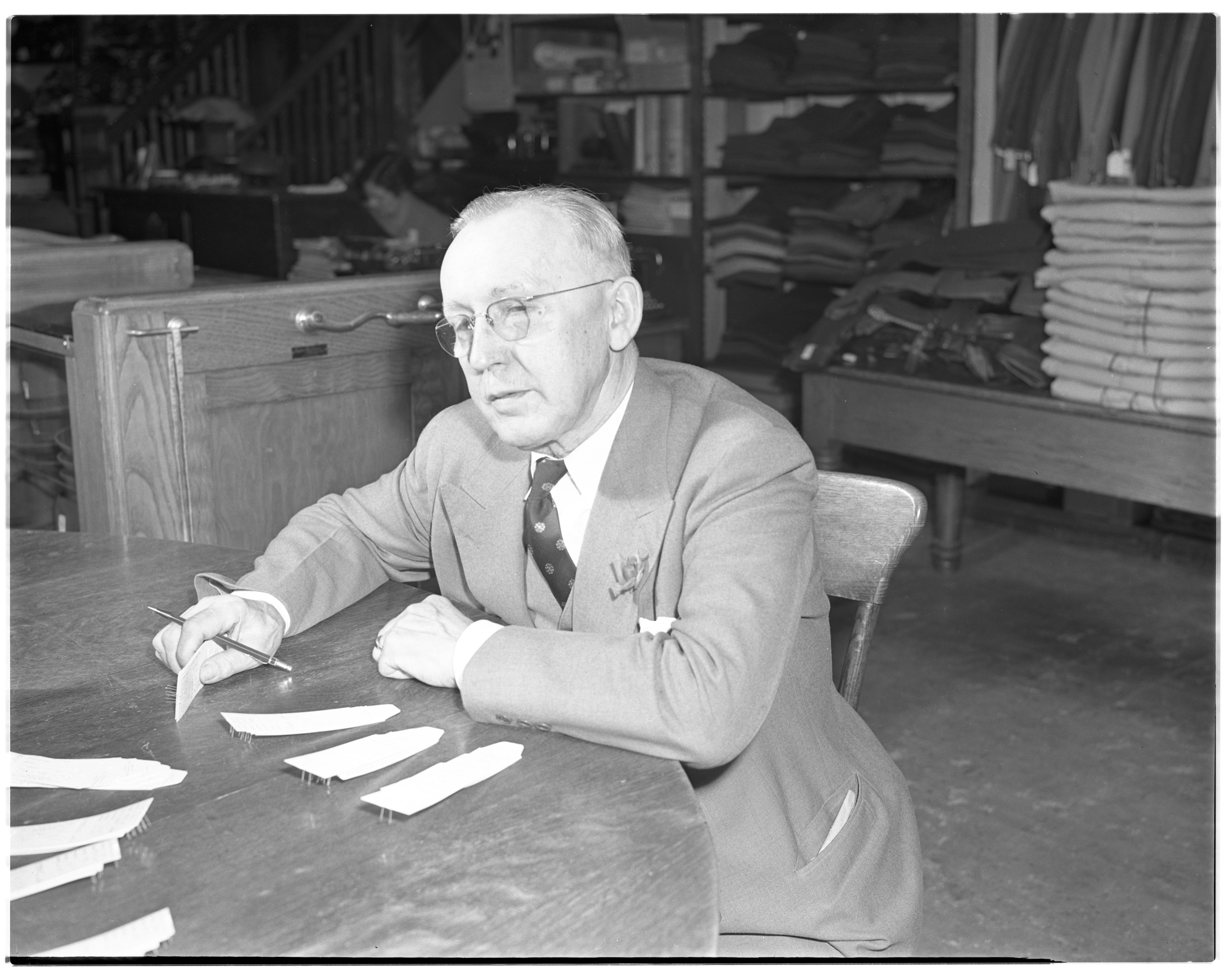 Albert Fiegel prepares price tags for Fiegel's 50th anniversary, September 1941 image