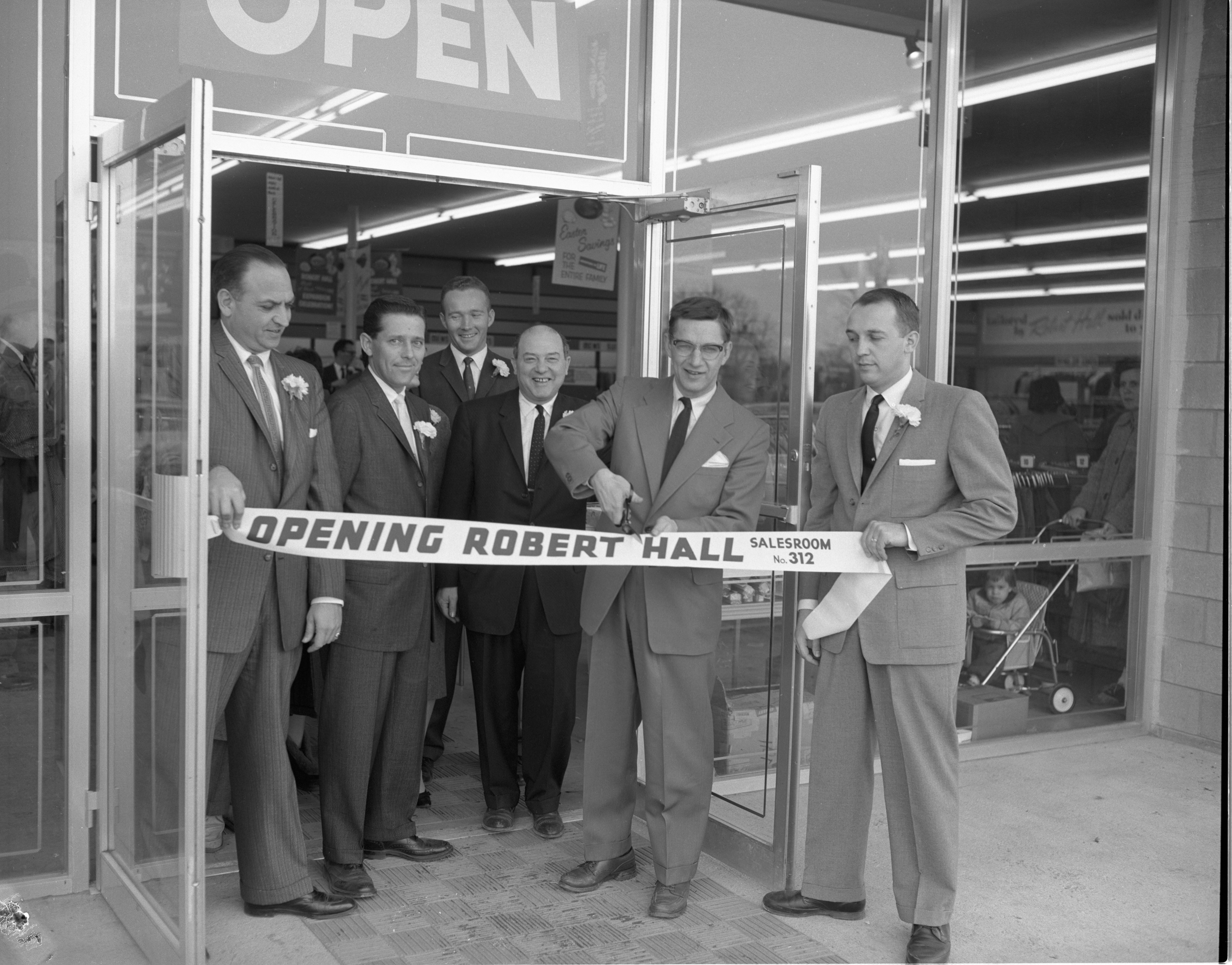 Mayor Eldersveld Cuts The Tape To Formally Open The New Robert Hall Clothes Store, February 1959 image