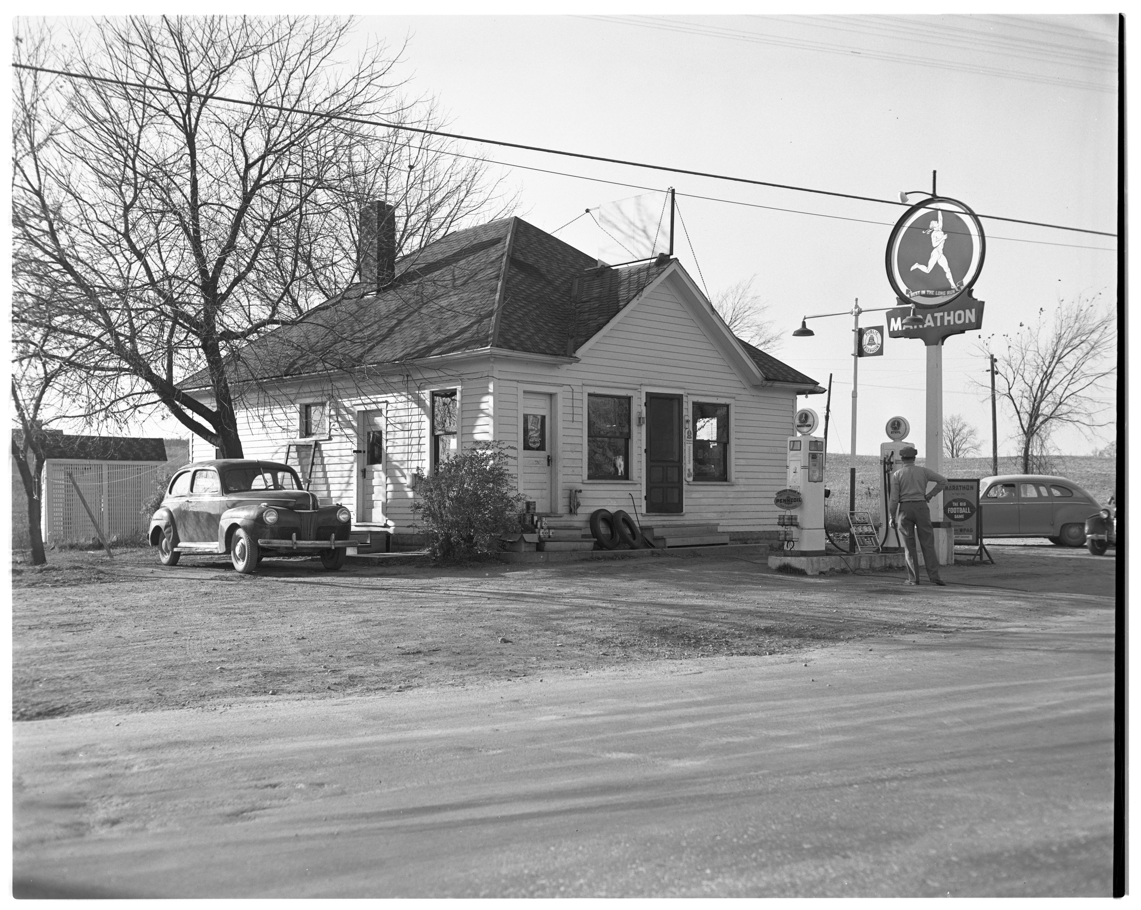 Groceries and filling station, November 1951 image