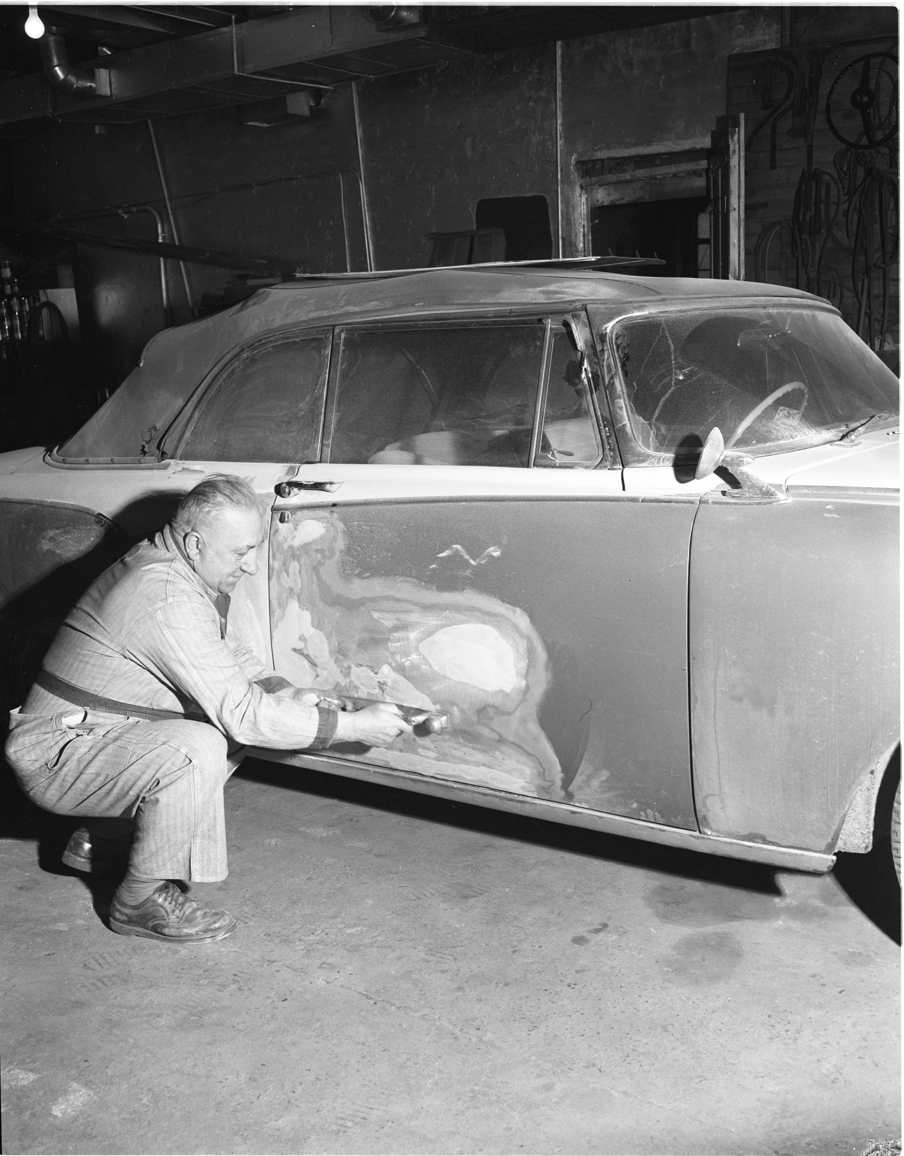 Charles Yahr Works On A Car At His Garage, January 1959 image