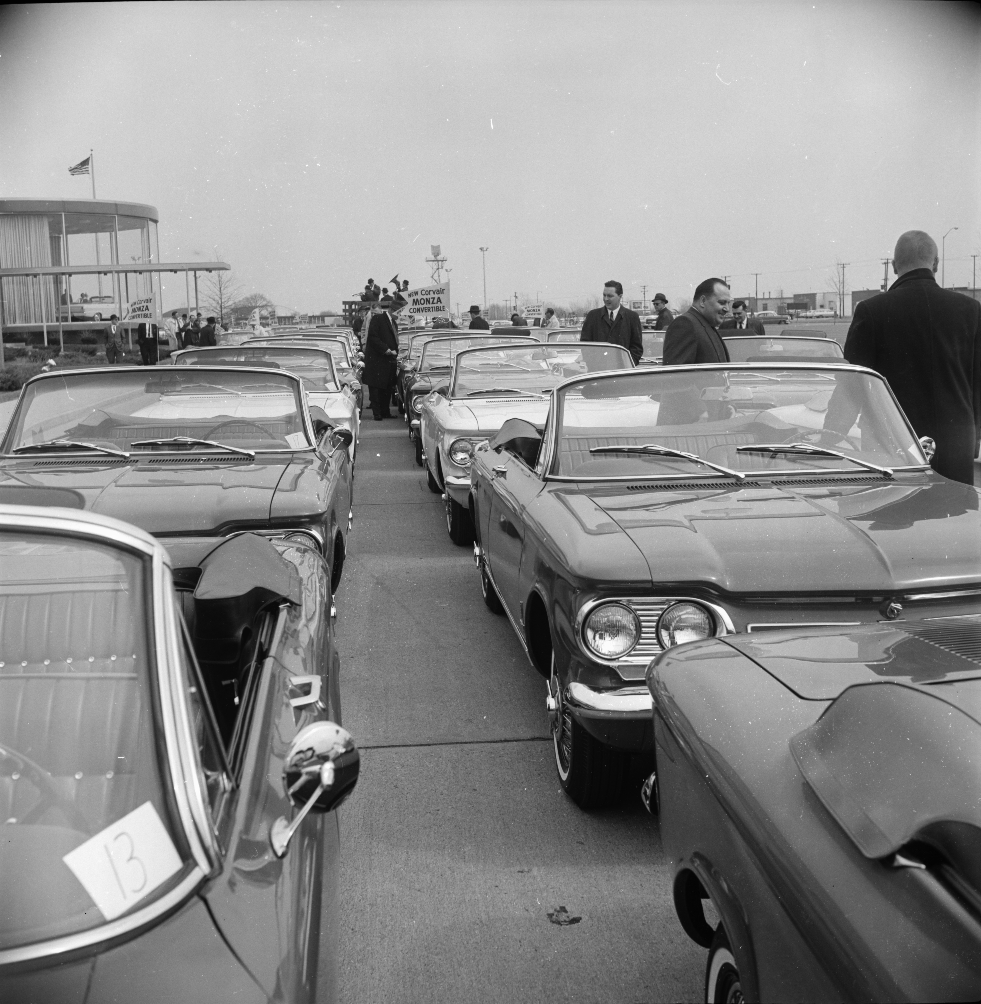 "New Corvair Monza convertibles lined up for a ""drive-away"" from GM's Chevrolet Division Assembly Plant at Willow Run, April 1962 image"
