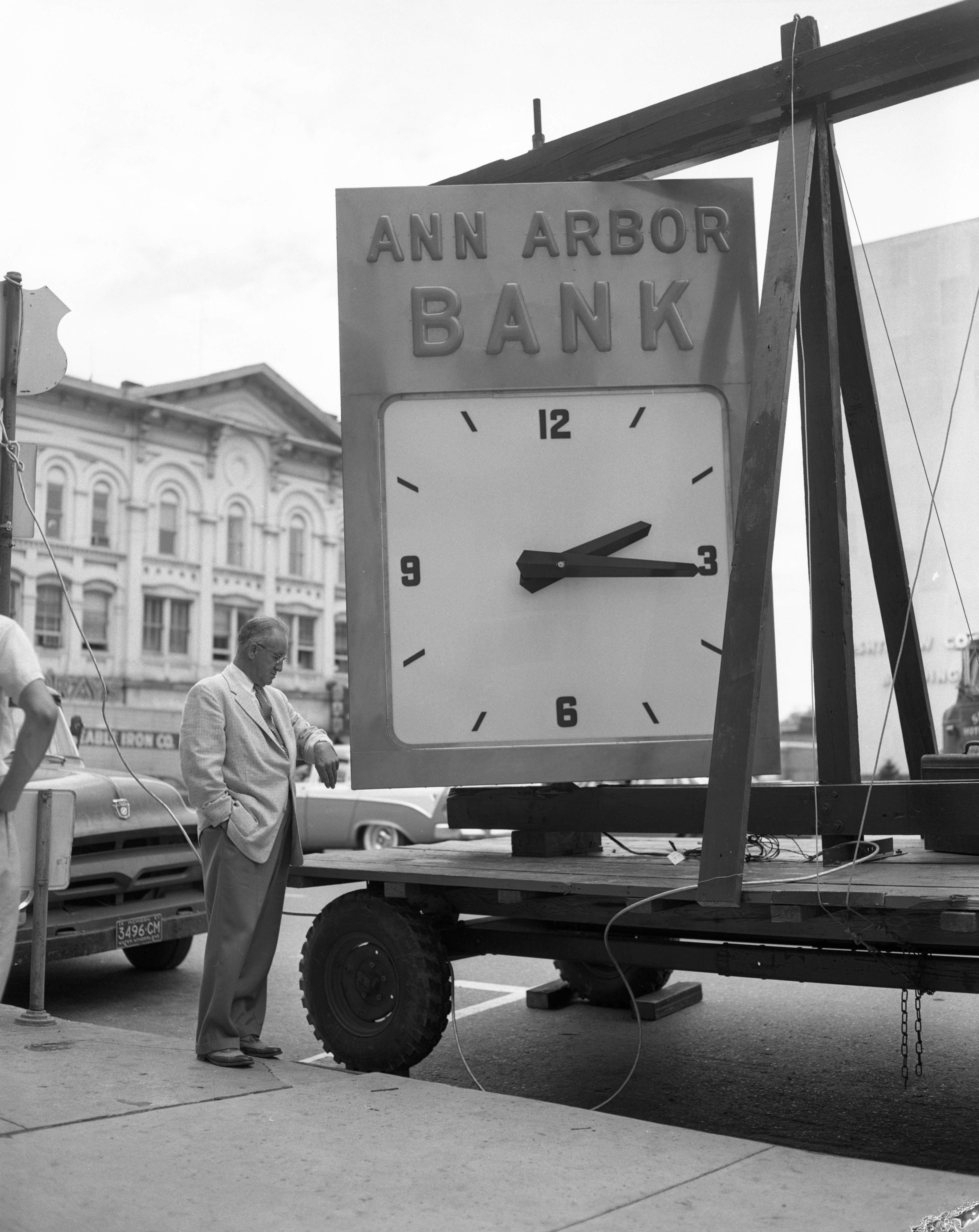 Ann Arbor Bank installs a big clock, July 1957 image