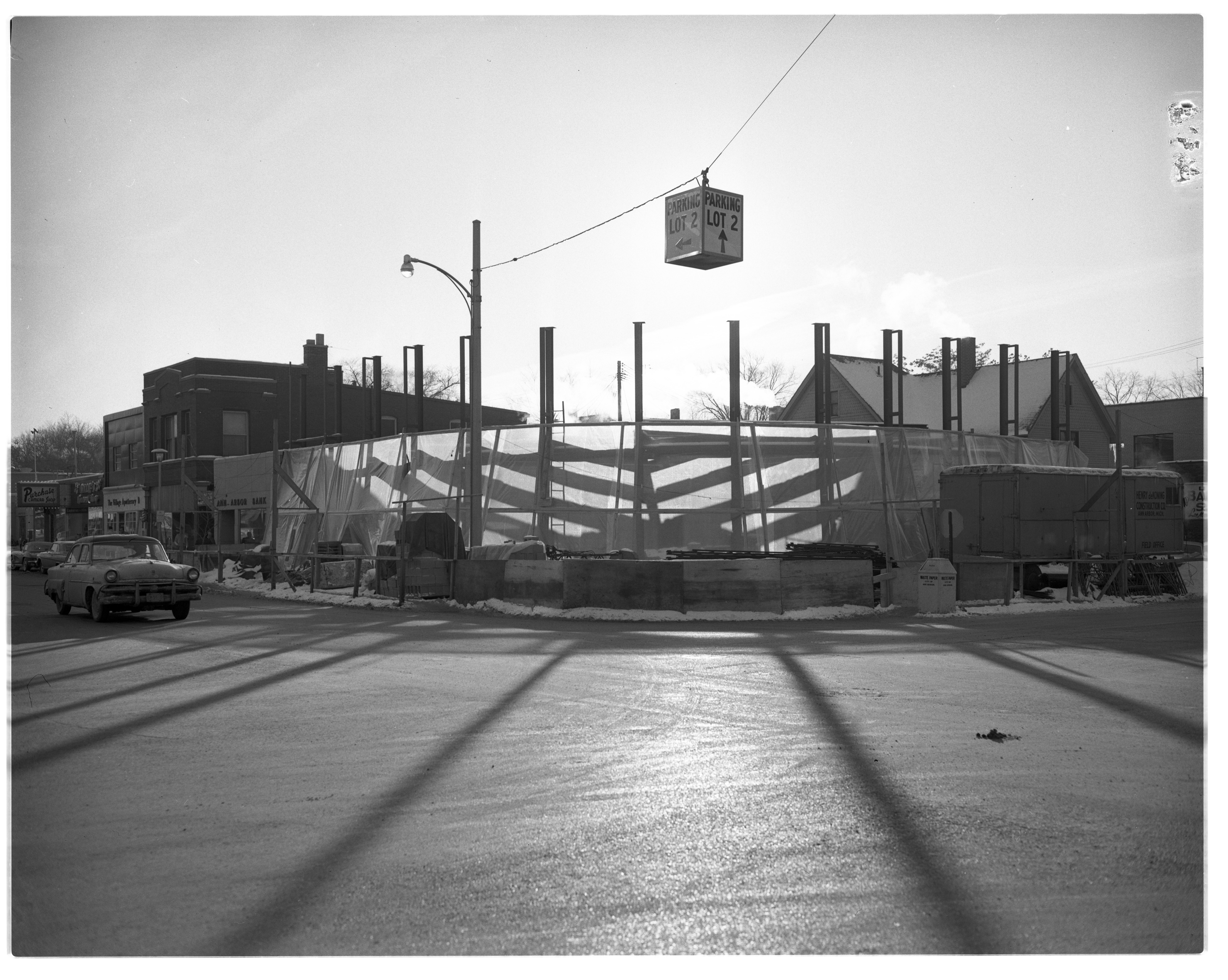 Plastic Cover Around Bank at S. University and E. University, February 1963 image