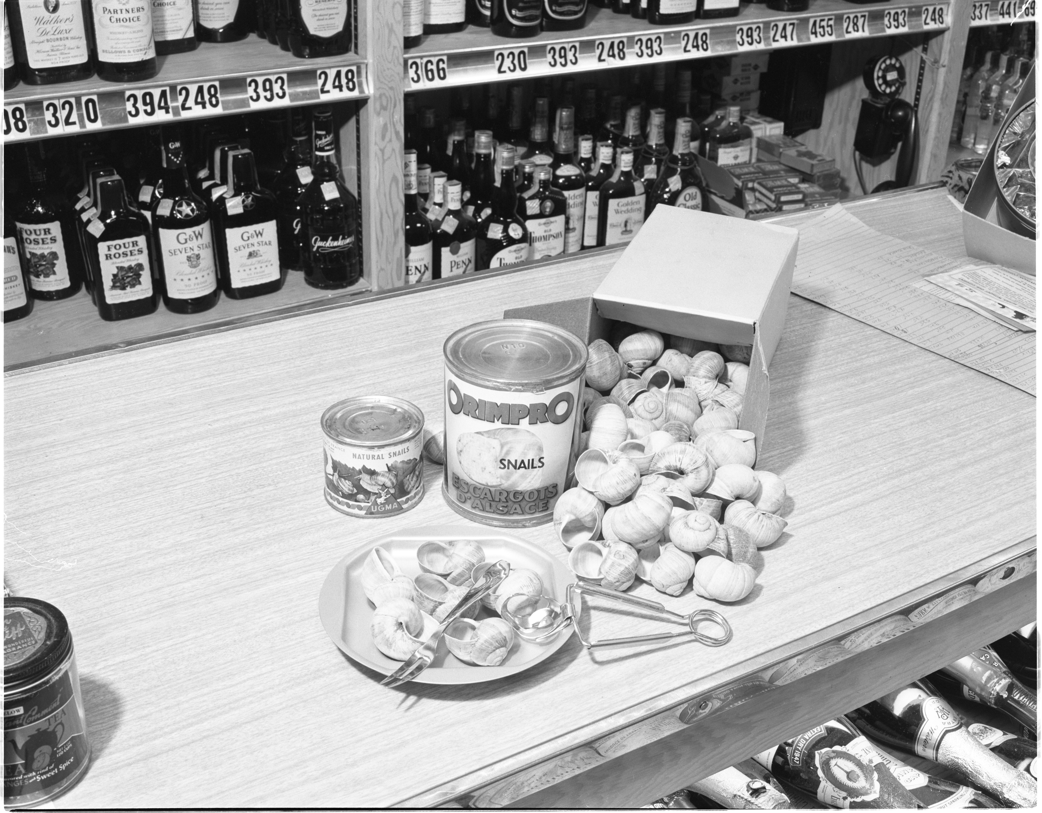 Liquor & Snails Display At Big Ten Party Store, November 1955 image