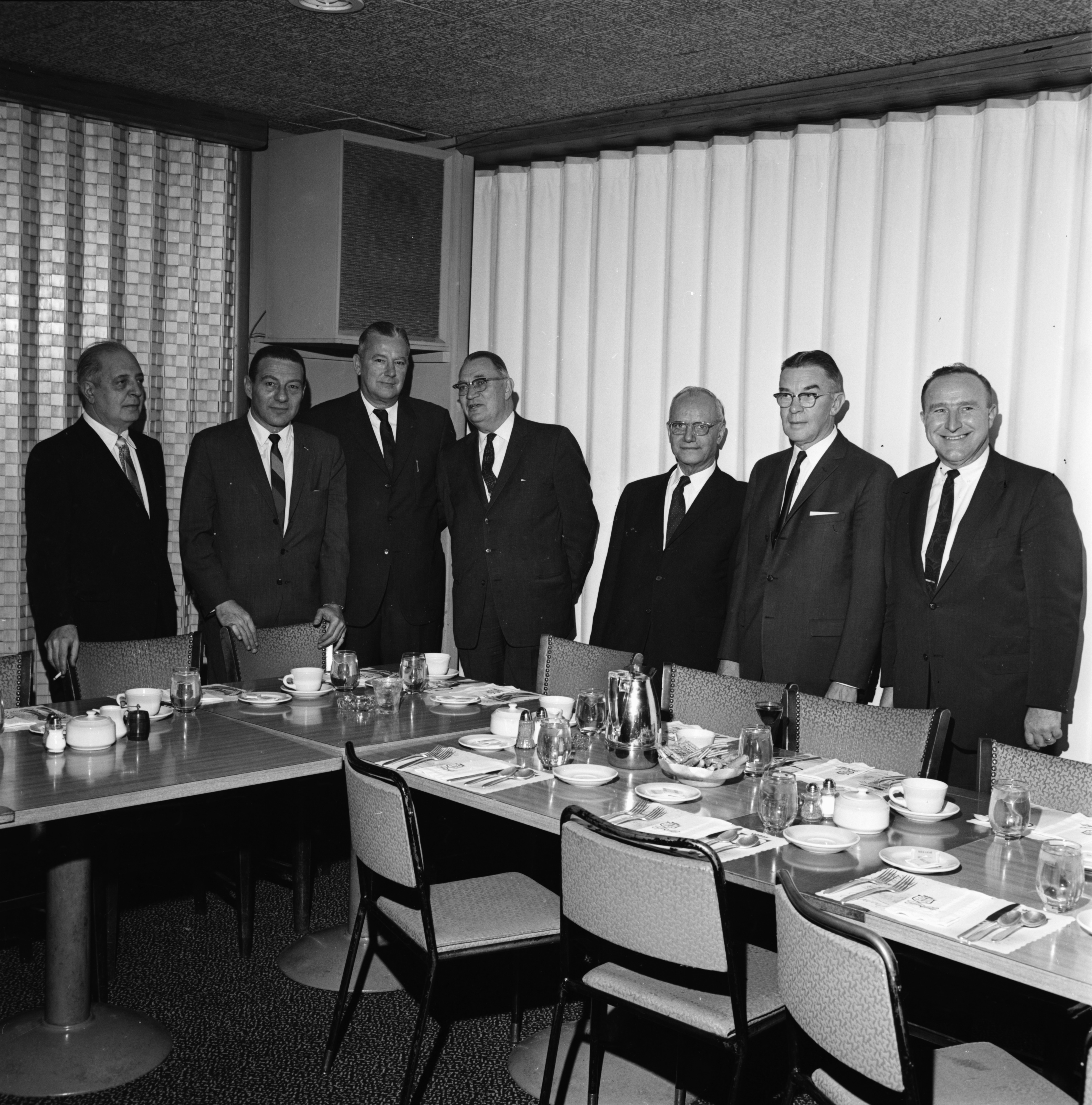 Hotel Developers and supporters discuss an 11-story $3,000,000 hotel to be built at E. Huron and S. Fourth Avenue, December 1963 image