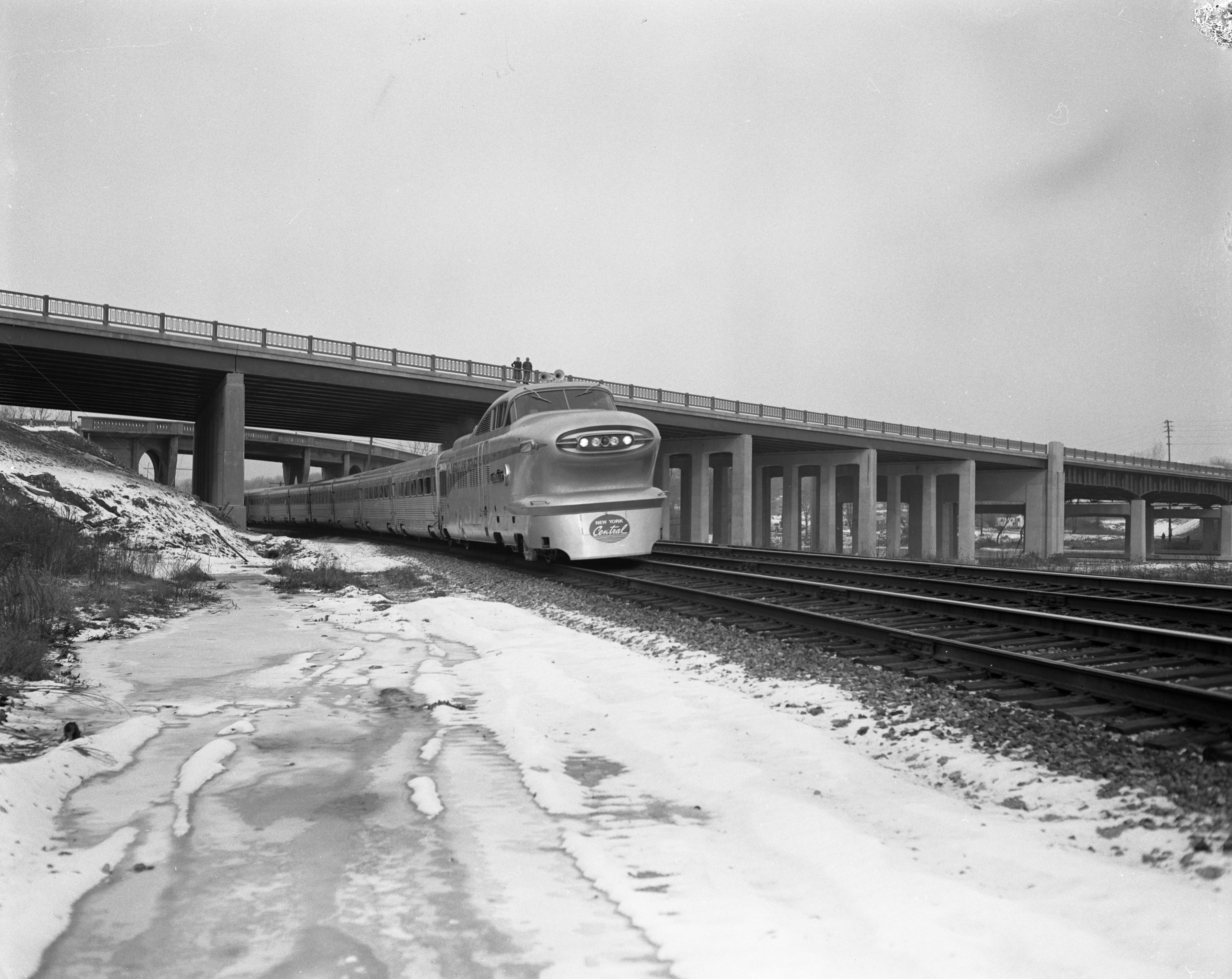 The New York Central's new Aerotrain passes under the Huron Valley Bridge, January 1956 image