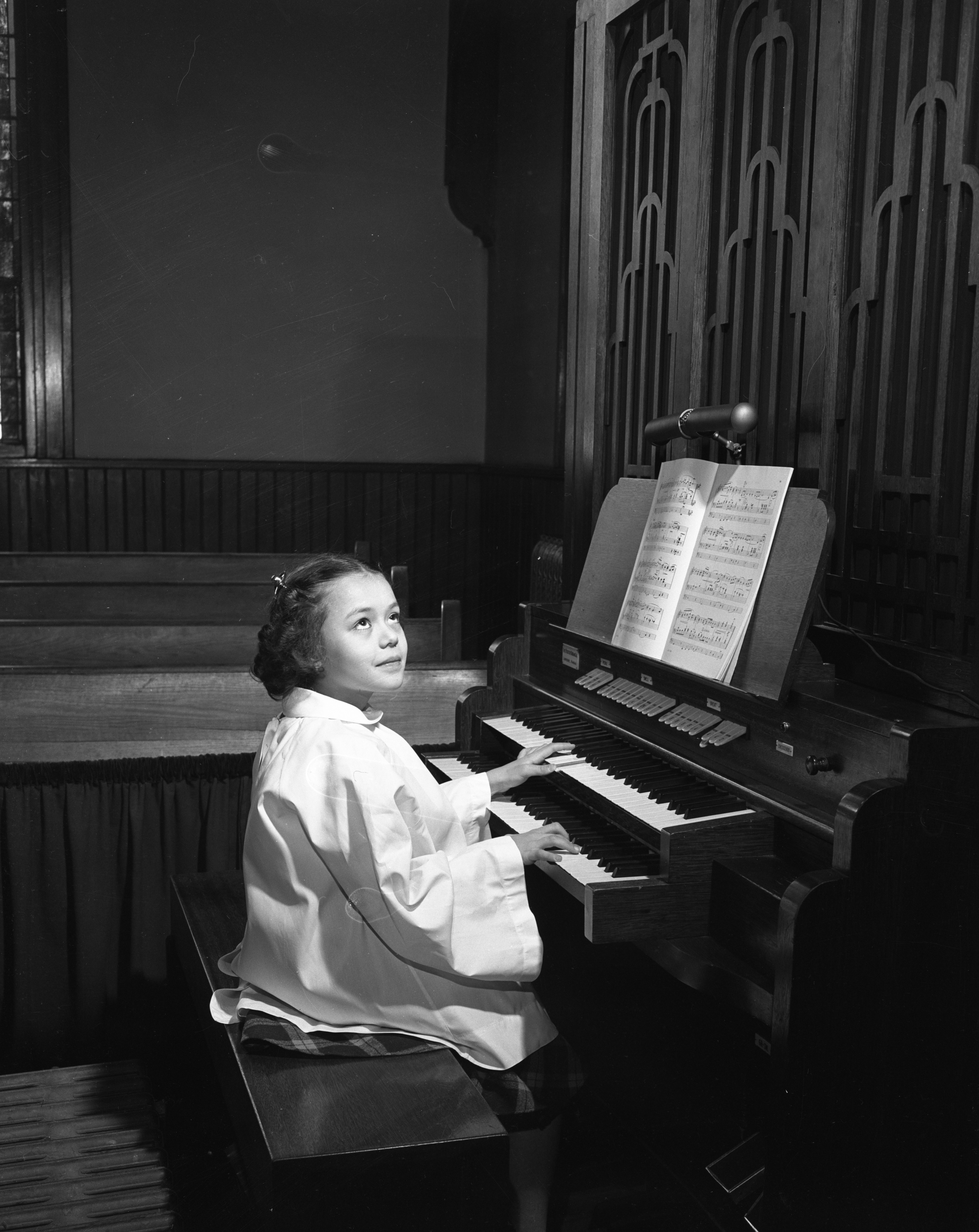 Elizabeth Ann Fawcett plays the organ at Trinity Lutheran Church, April 1950 image
