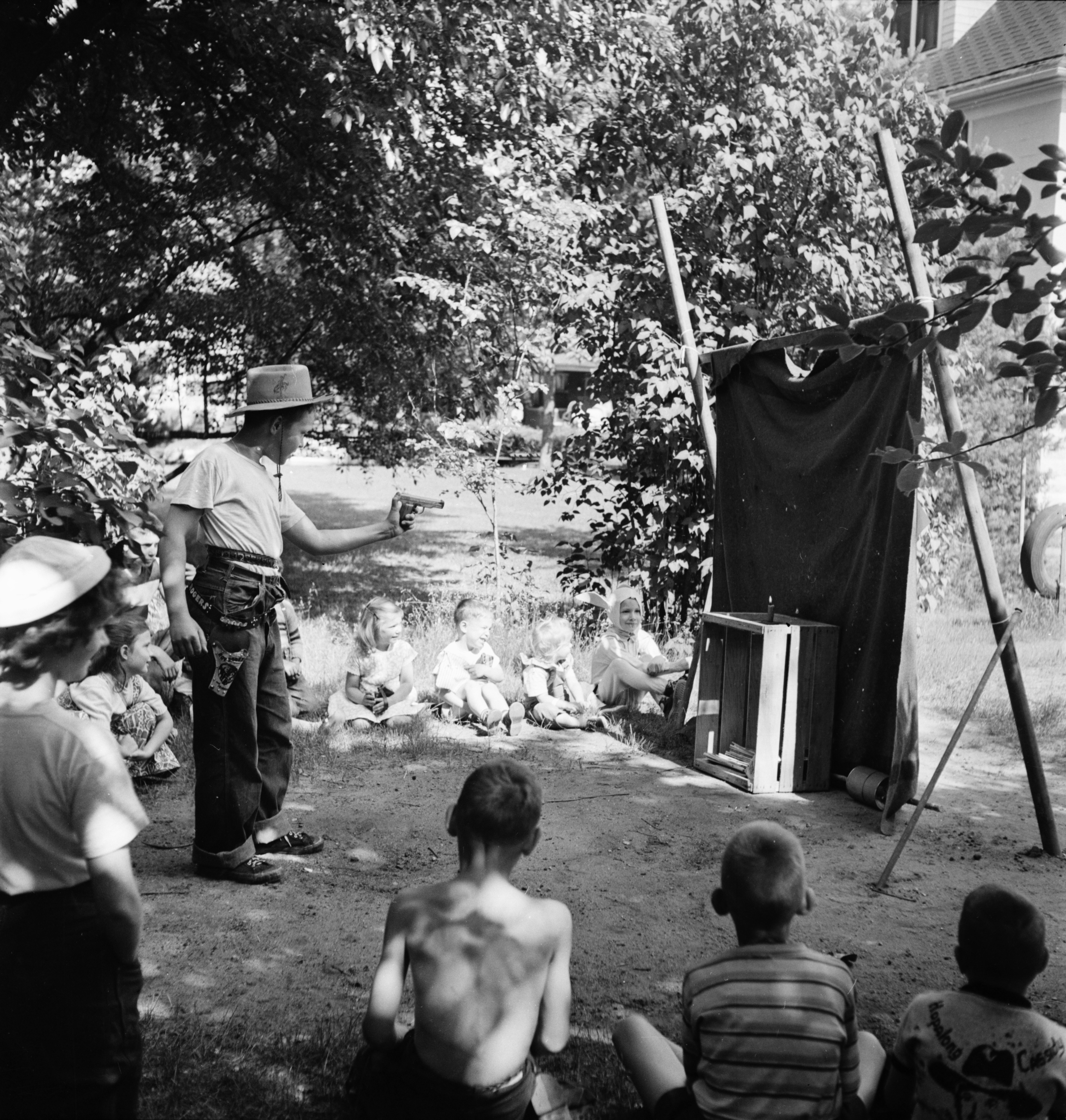Cowboy at a children's circus on Church street, 1950 image