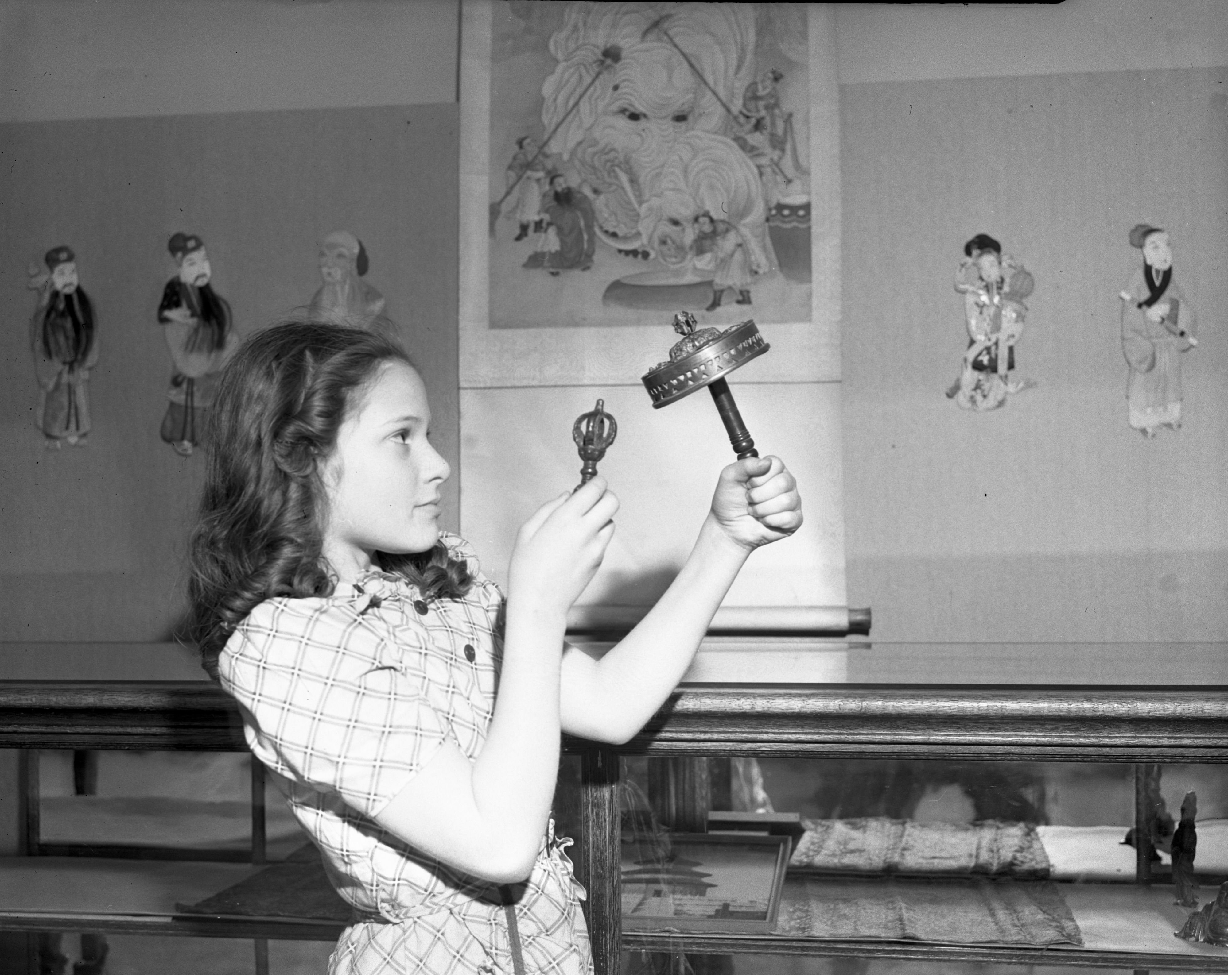 Eileen Westfall with a Tibetan Prayer Wheel and Thunderbolt at the Children's Museum, 944 Wall St, February 1941 image