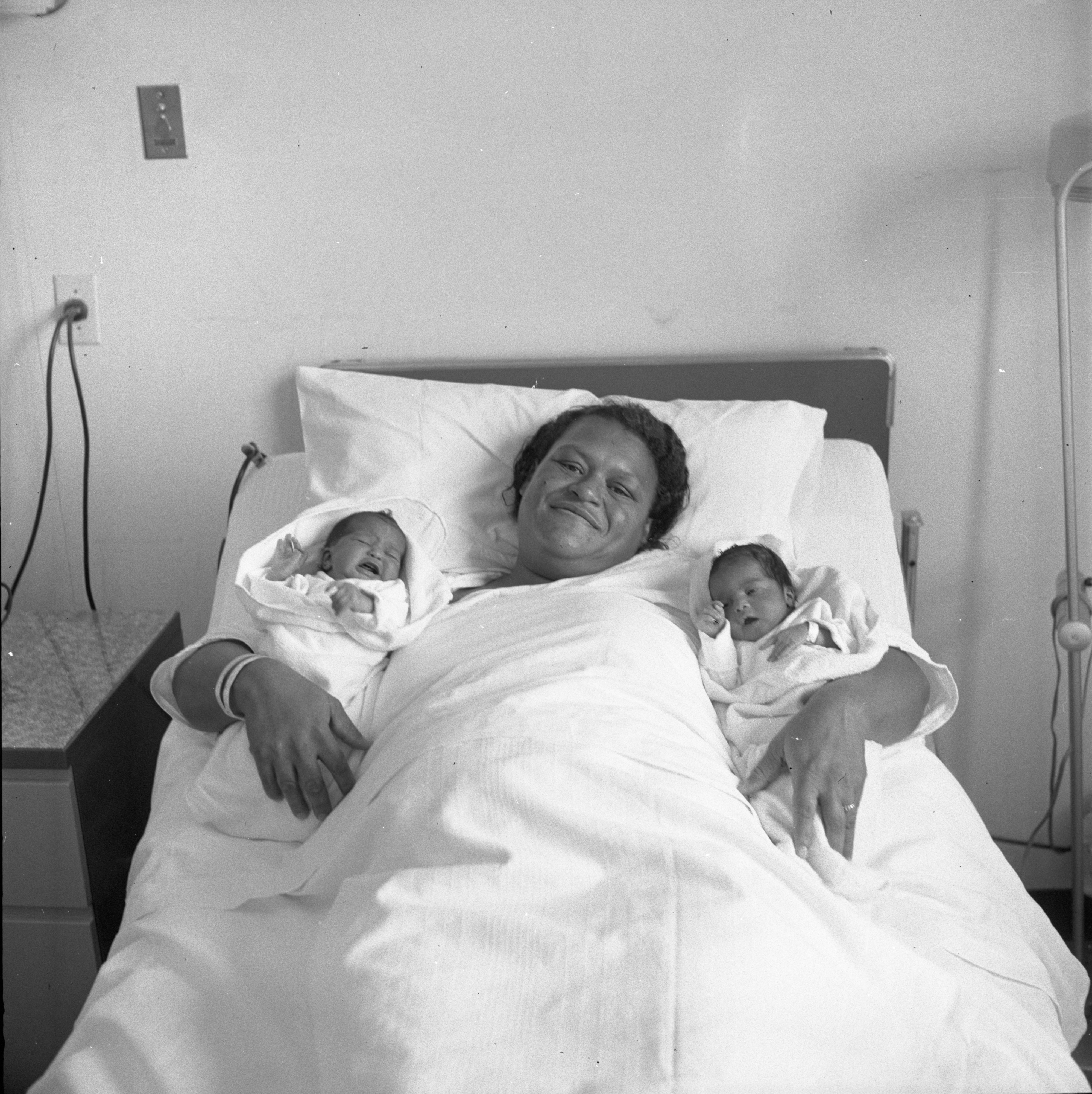 Mary Ann Birton With Twin Daughters Born On Different Days, November 1957 image