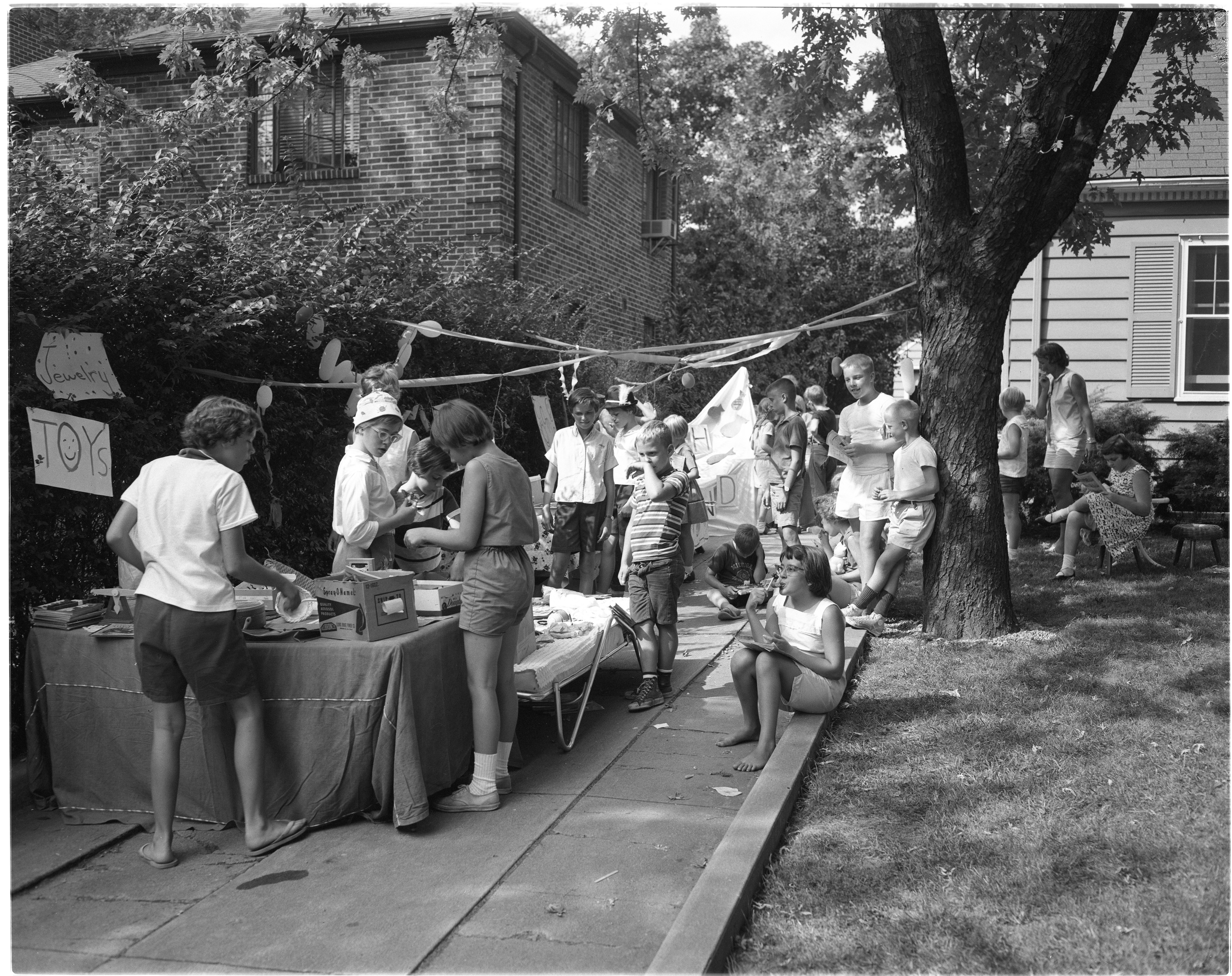 "Children from ""The Everything Club"" Hold a Bazaar to Benefit University Hospital, September 1960 image"