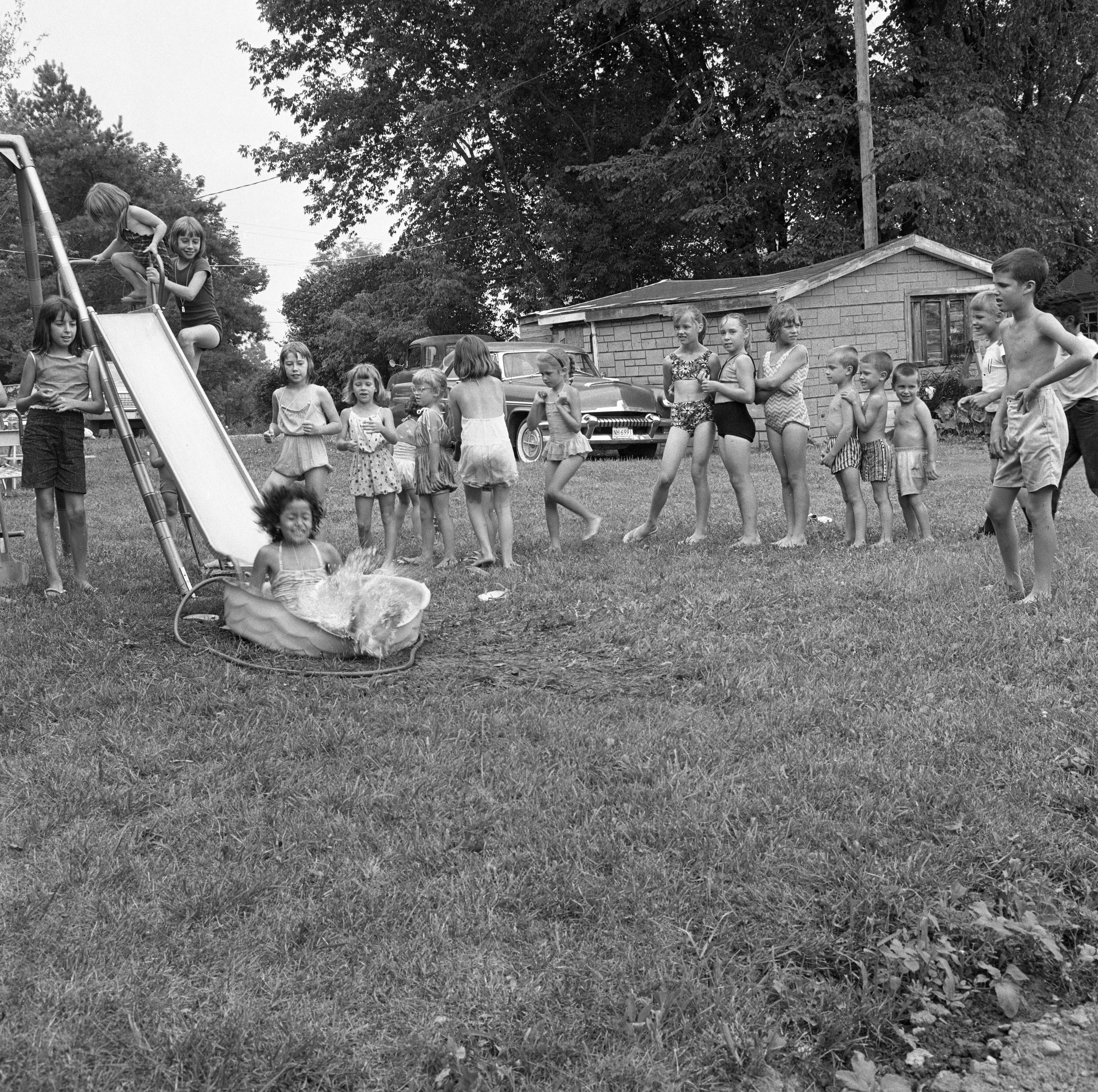 Neighborhood Children Slide Into Pool At Erwin Keppler Residence, July 1964 image